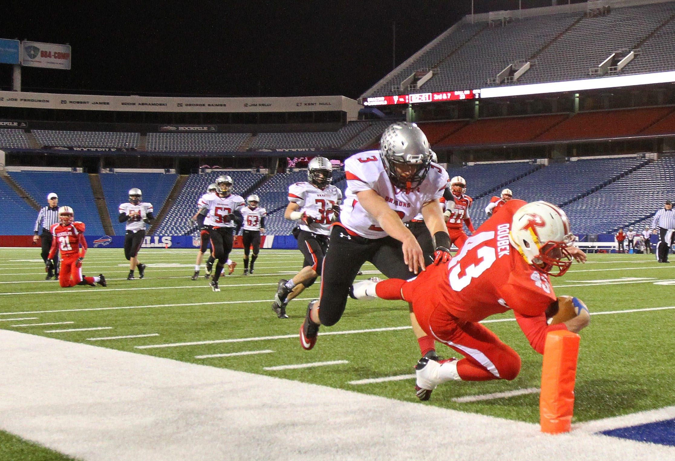 Randolph's Chris Doubek dives for a touchdown on Maple Grove/Chautauqua Lake's AJ Hulton in the first half at Ralph Wilson Stadium.