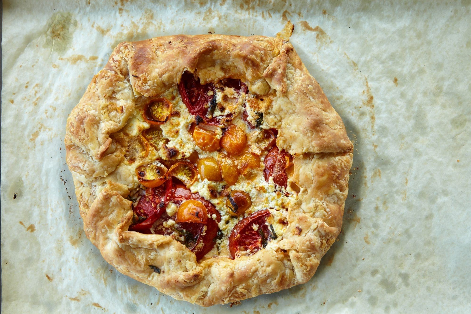 A bit of lemon juice makes a tender crust for this Rustic Heirloom Tomato Crostata.