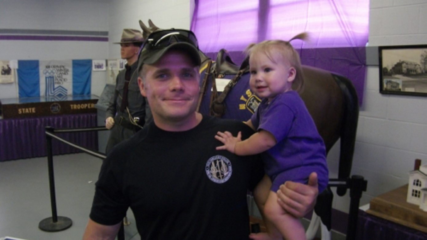 State Trooper Ross Riley is shown holding his daughter, Jillian. Riley died Monday during a training exercise.