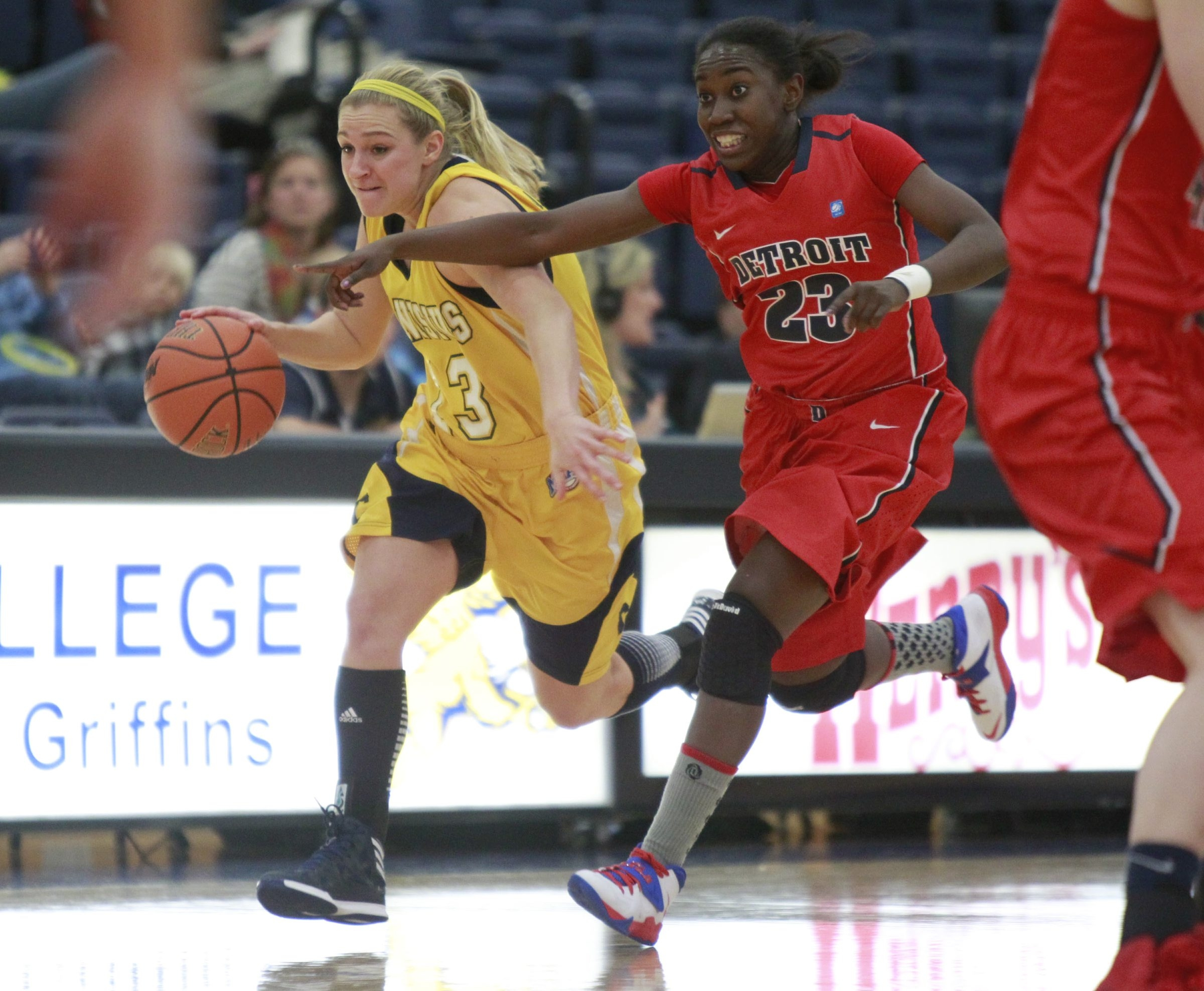 Canisius' Brooke Angelos heads up court against Detroit's Senee Shearer at the Koessler Athletic Center on Friday.