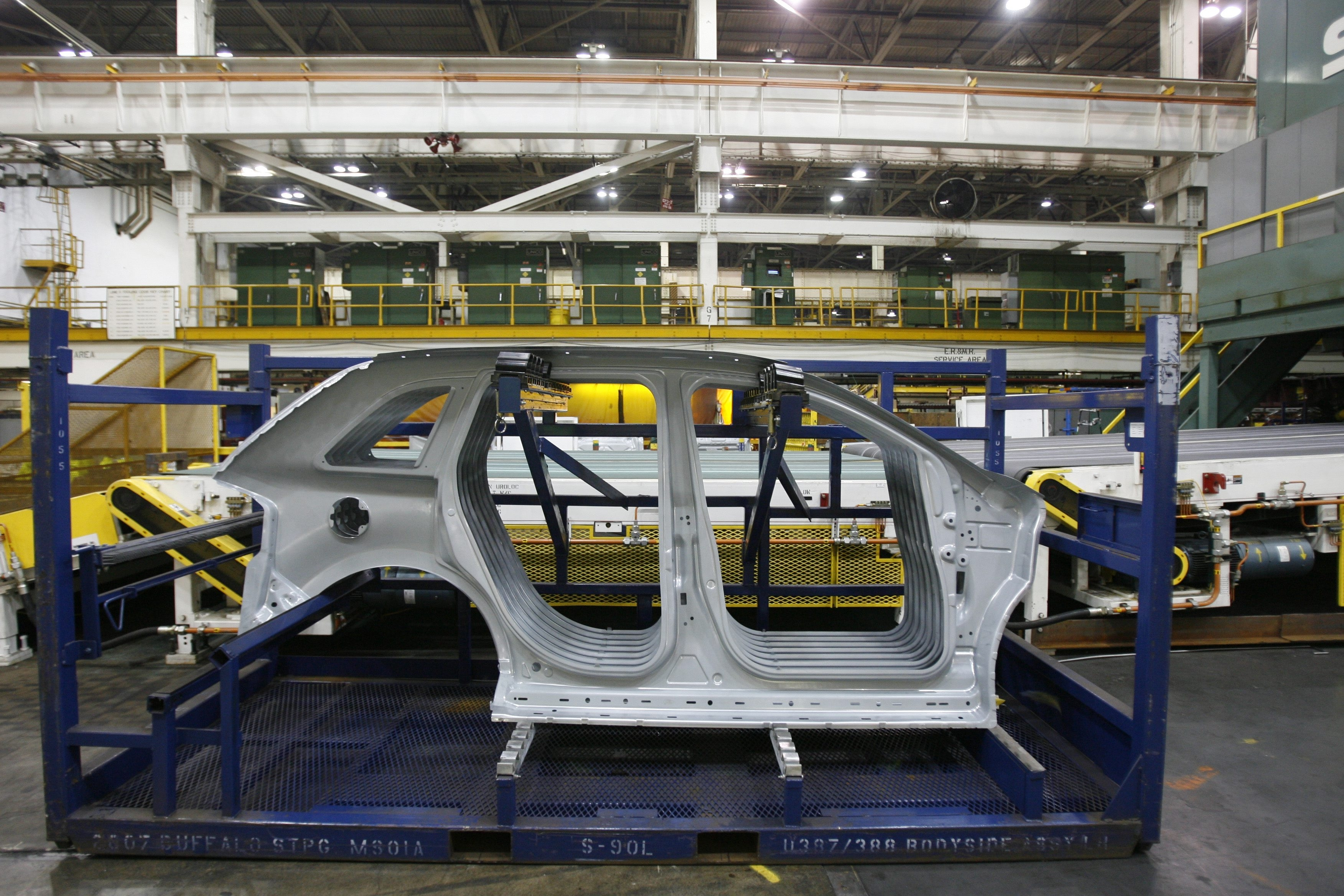 Side body panels for the Ford Edge hang on a rack after being pressed into shape at the Ford Motor Co. Buffalo Stamping Plant on Route 5 in Hamburg in this photo.