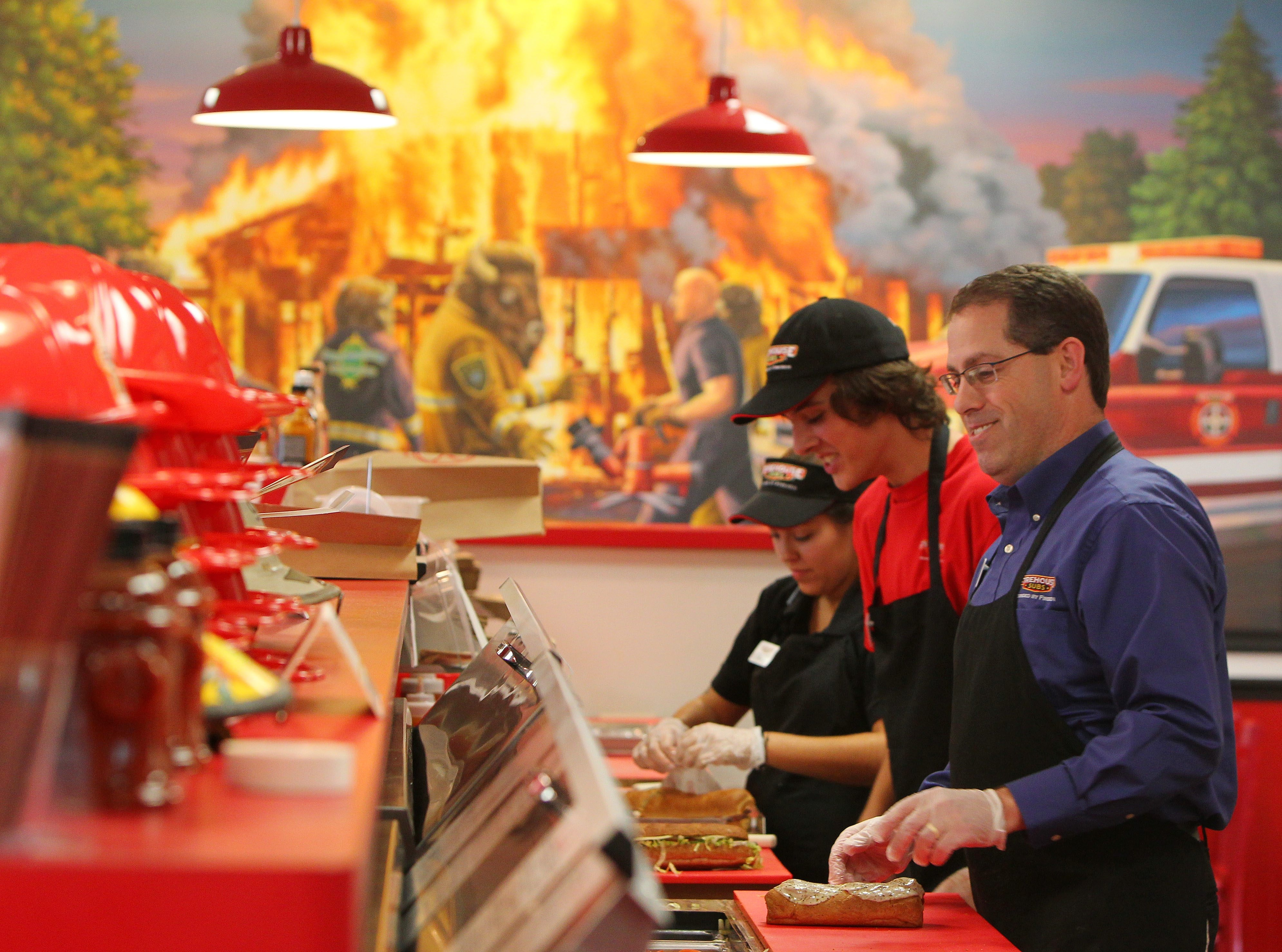 Firehouse Subs franchise owner Mark Harris said the details from the company helped him get his shop in Clarence started.   Mark Mulville/Buffalo News