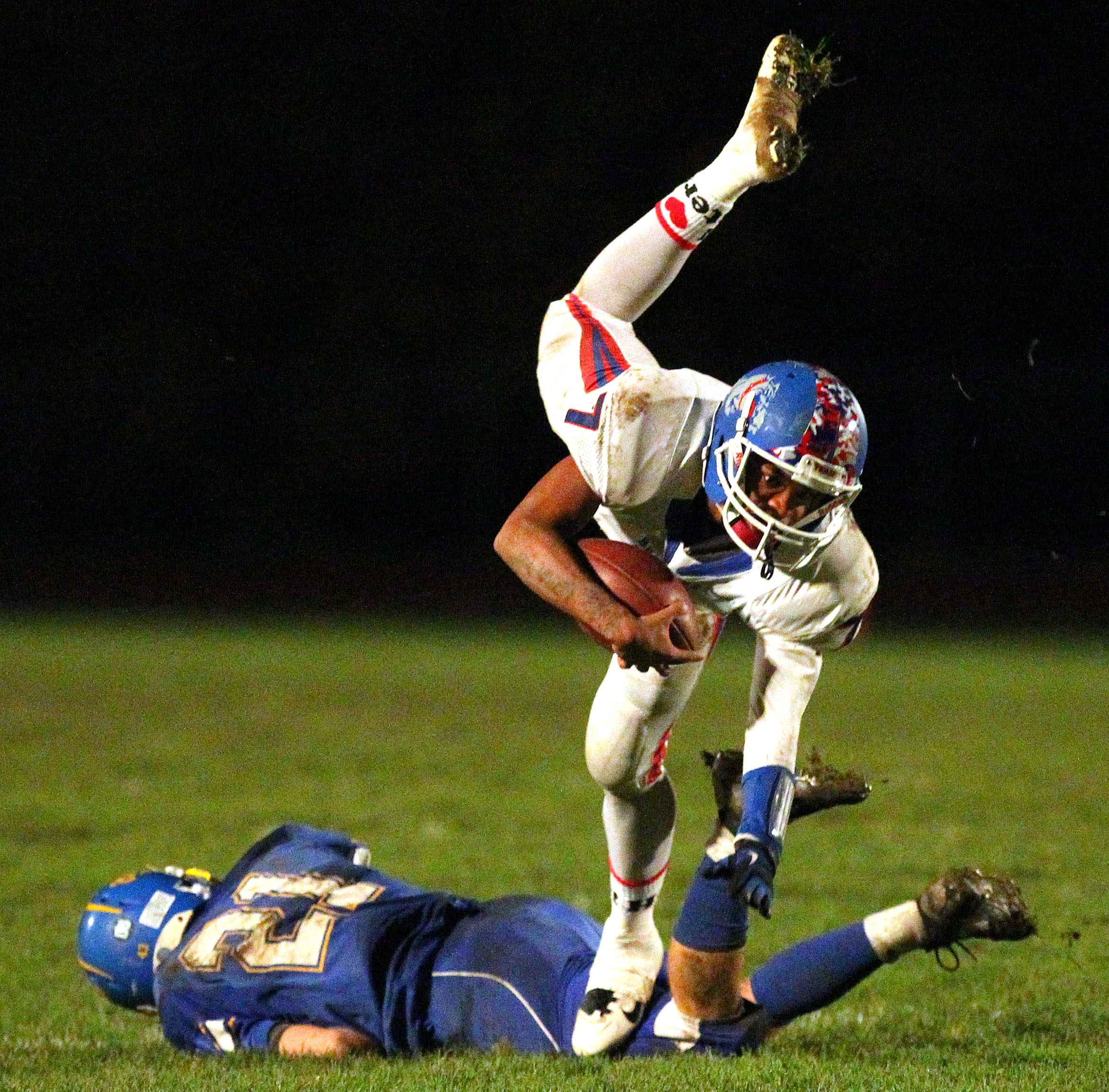 Burgard's Rayshawn Jones gets tripped up by Alden's Lyle Grant in the first half of the game at Alden on Friday.