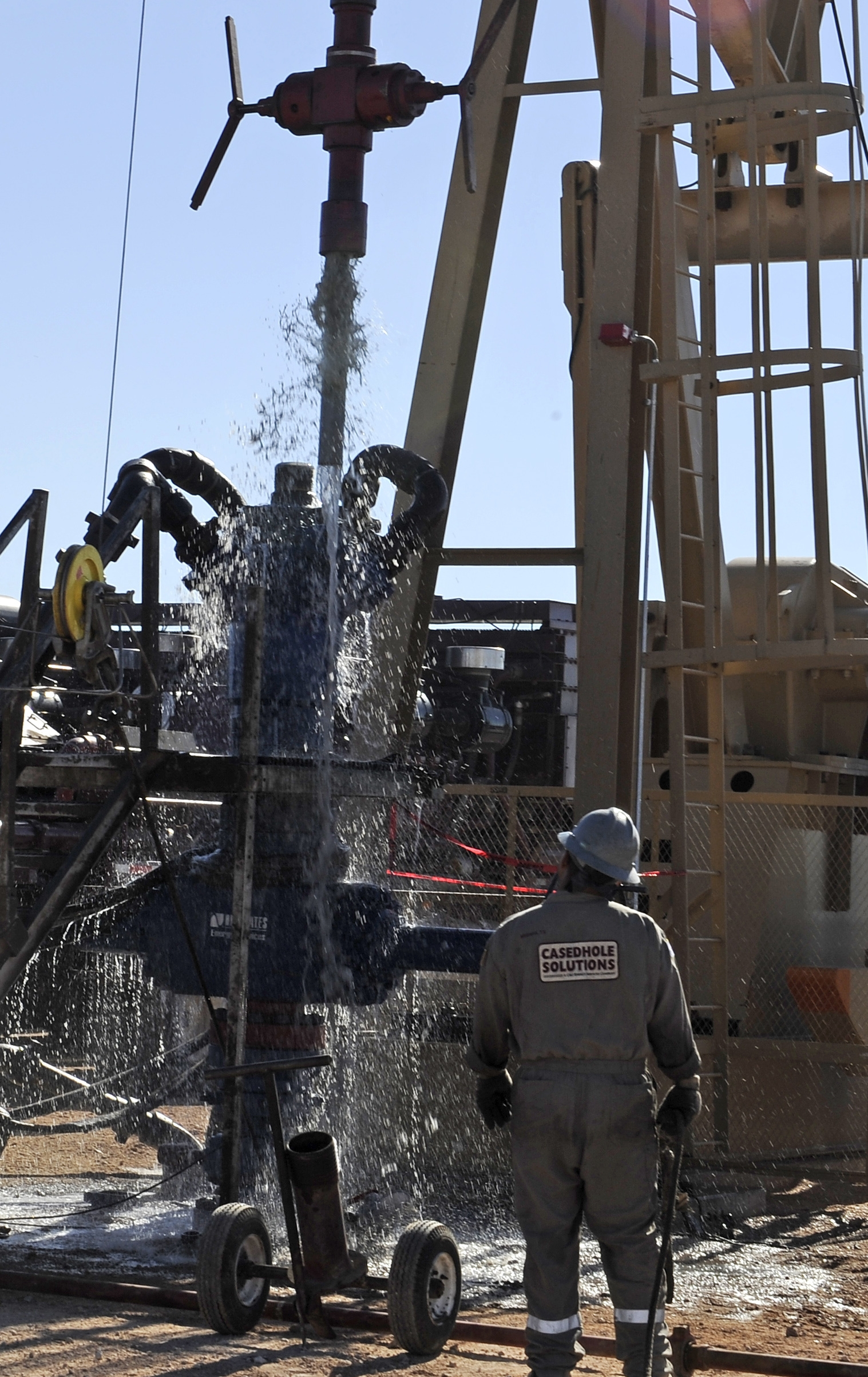 Water gushes out of a drilling pipe as it is pulled up to be replaced with a fresh pipe at a hydraulic fracturing site in Midland, Texas.