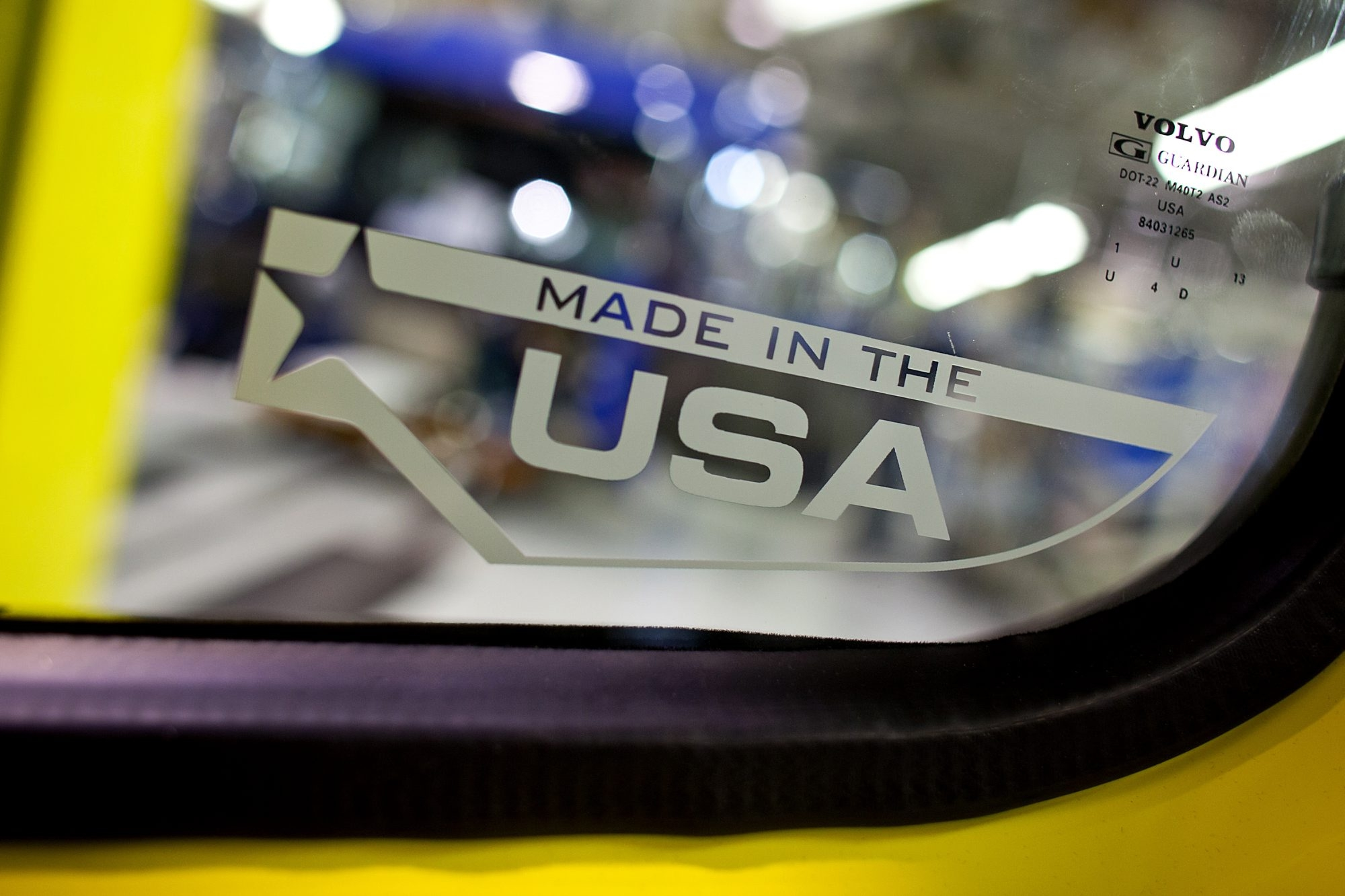 "A ""Made in the USA"" sticker is placed on a truck window at the Volvo AG New River Valley Plant in Dublin, Va. The notion of buying an American car is especially complicated these days."