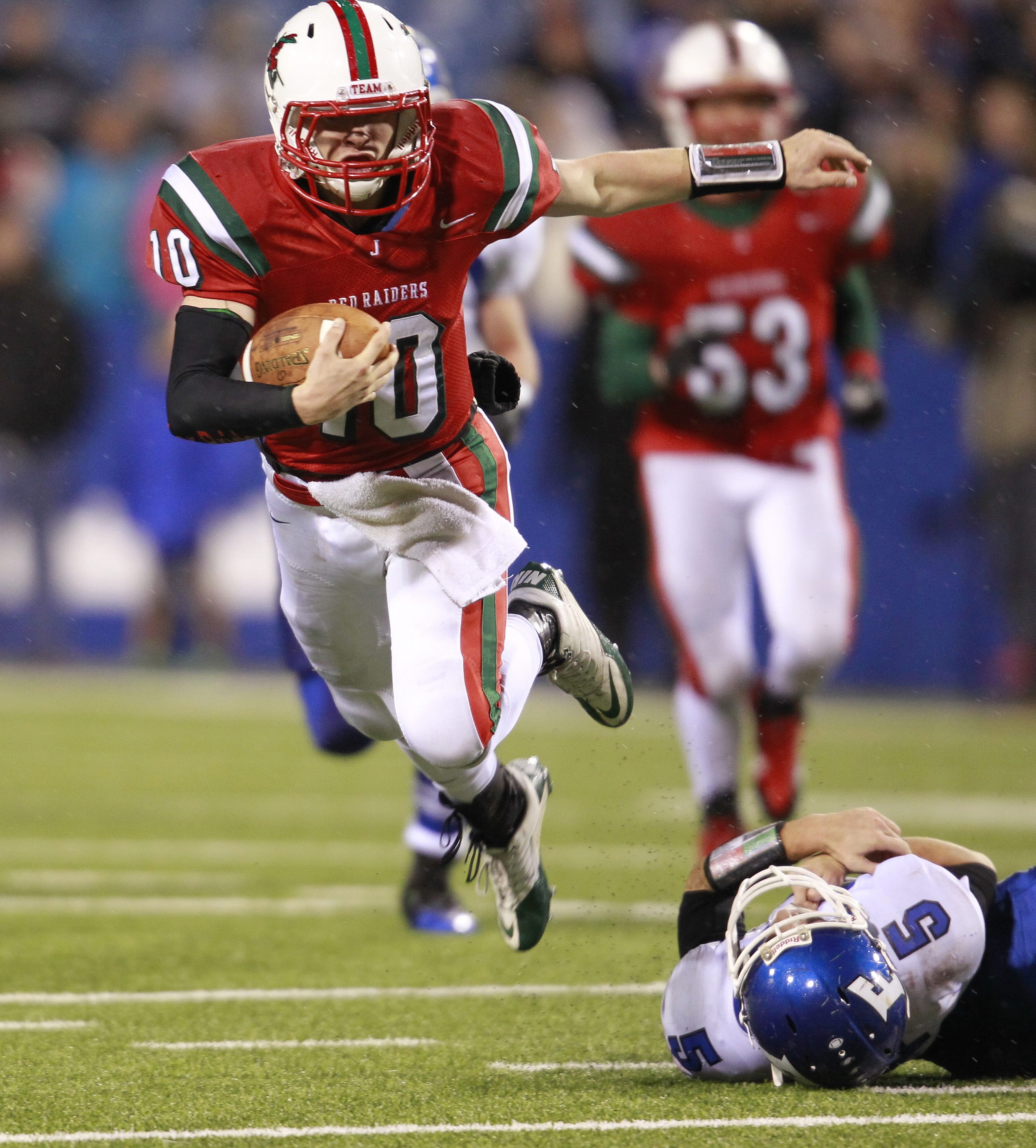 Jamestown quarterback ,Jacob Sisson, leaps over Frontier player, Vinny Pupo (5) during first half actio during the Class AA Championship,at Ralph Wilson Stadium,on. Saturday, Nov. 9, 2013.(Harry Scull Jr./Buffalo News)