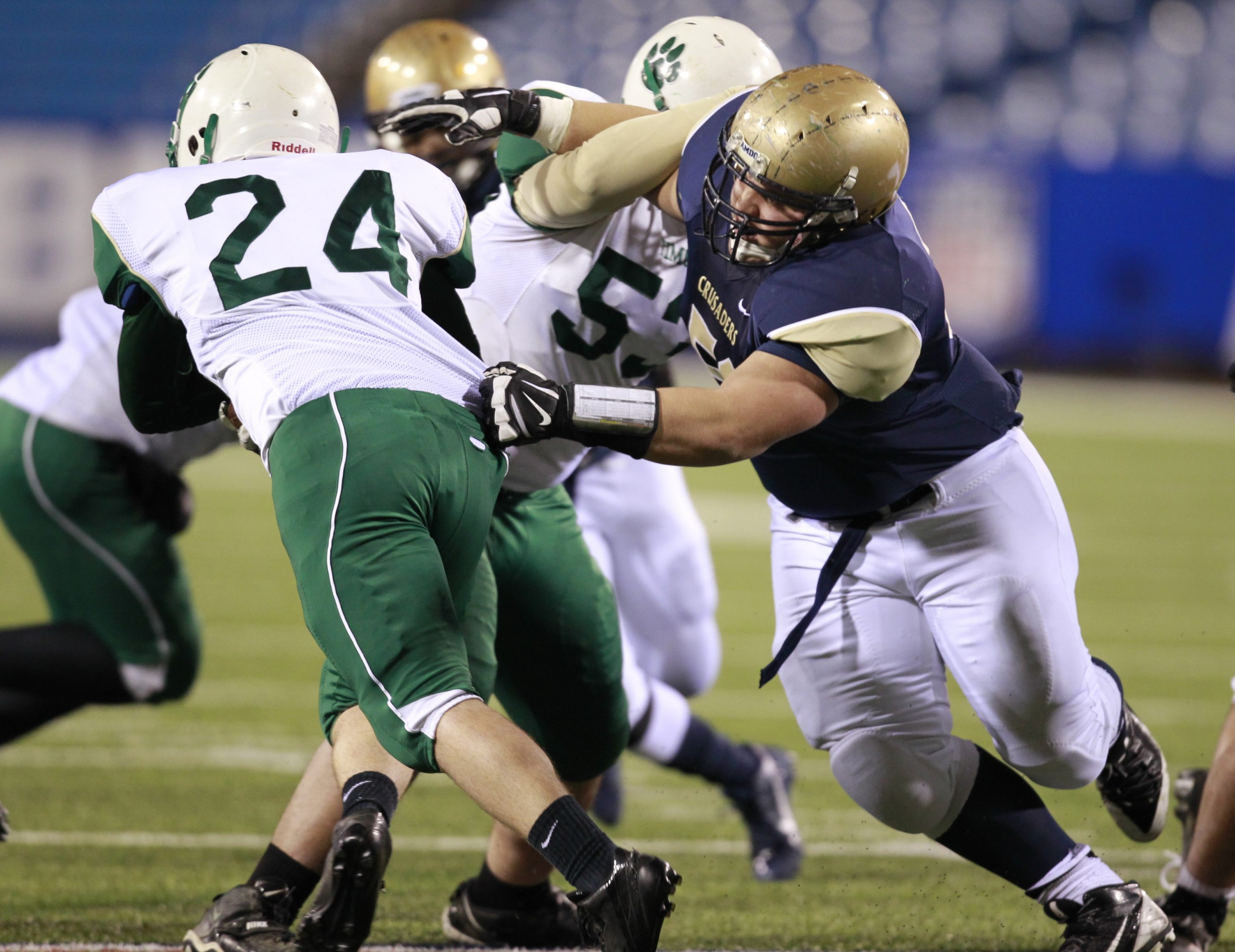 David Koeppel of Canisius, right, reaches to tackle Brady King of Bishop Timon-St. Jude during their Monsignor Martin Association semifinal. The Crusaders will meet  St. Joe's for the MMA title next Thursday.