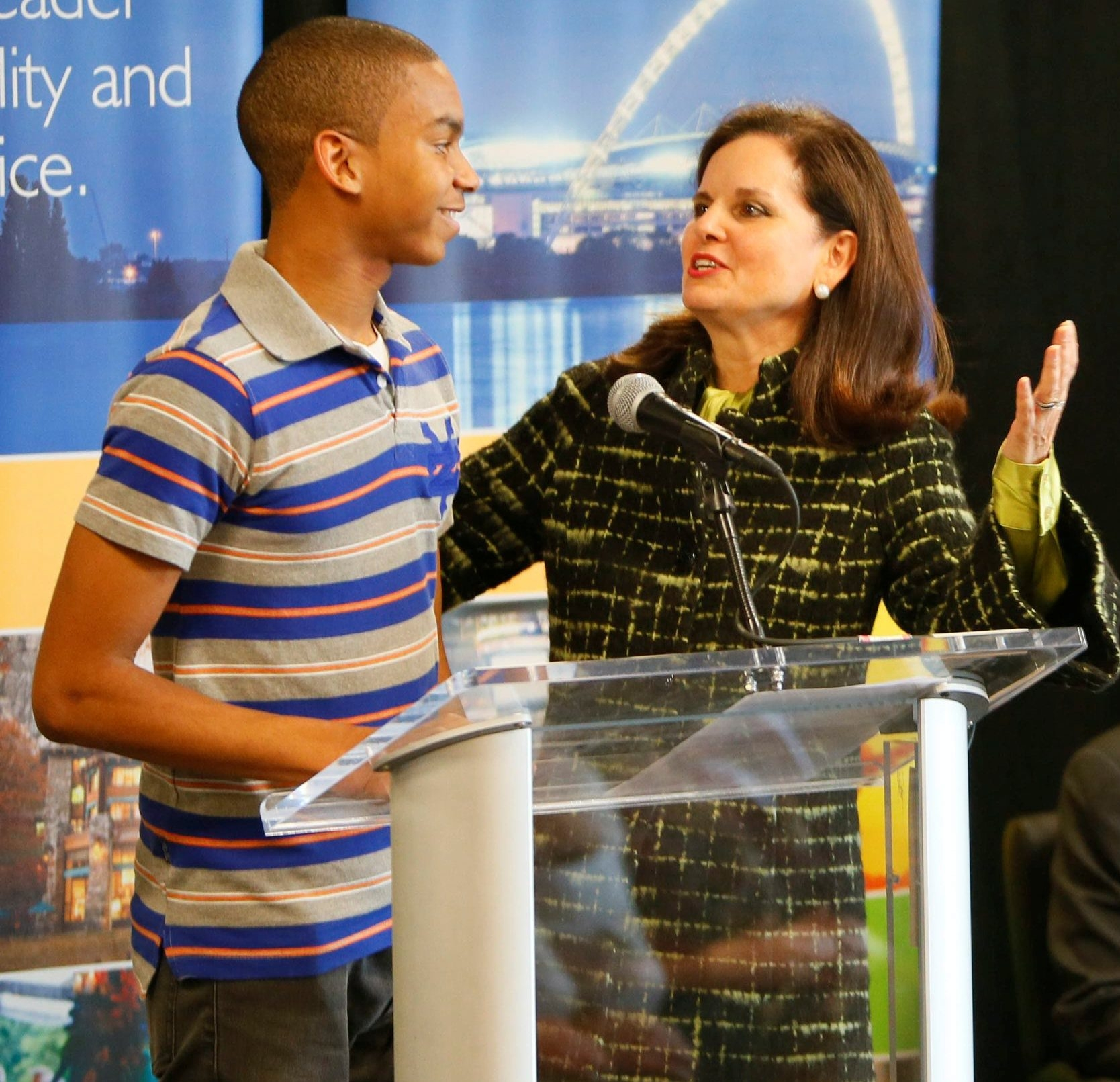 Emerson School of Hospitality senior Rayshawn Downs, 17, left, and Say Yes to Education Buffalo board member Clotilde Perez-Bode Dedecker, president and CEO of Community Foundation for Greater Buffalo, speak during a Say Yes to Education event last year.