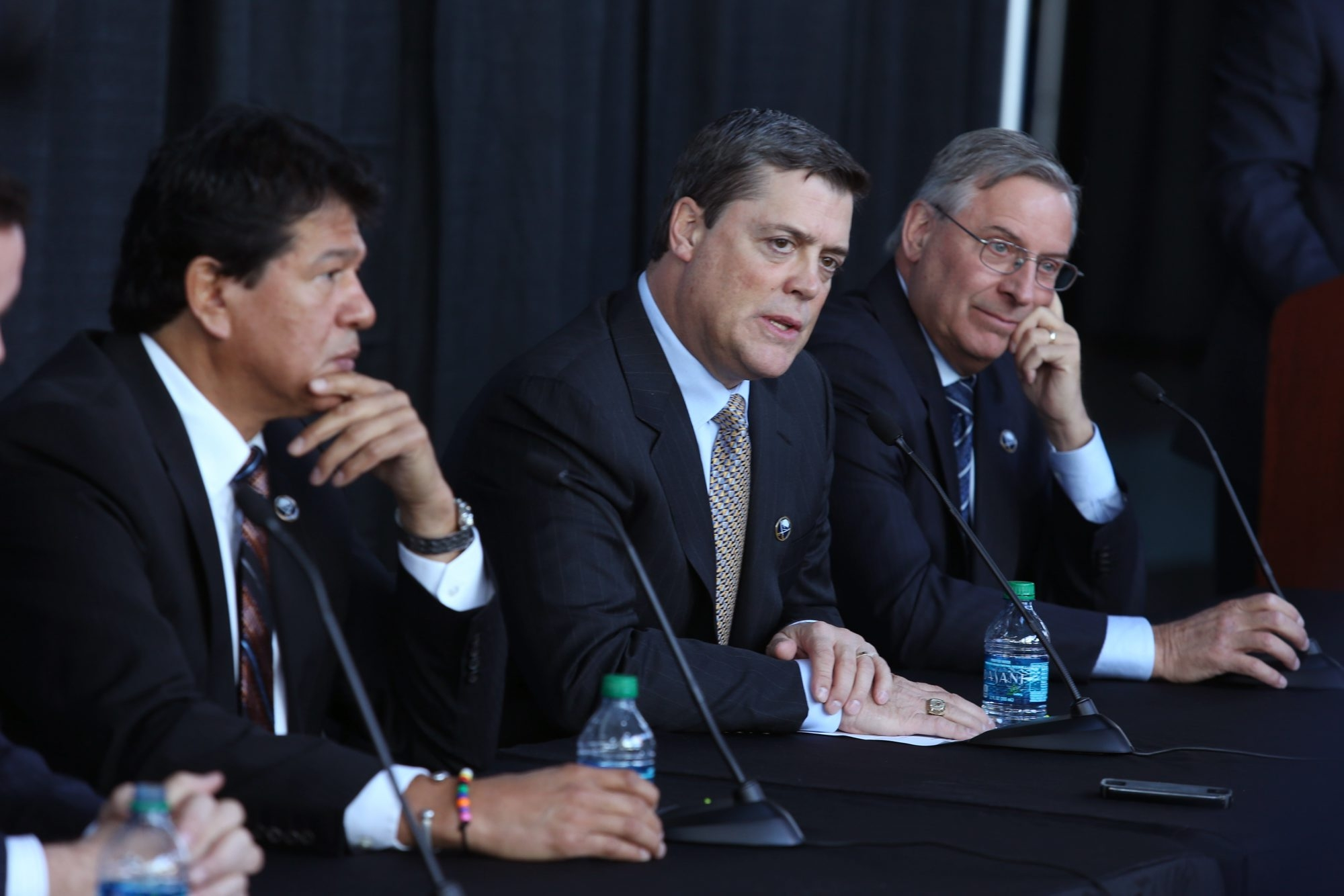 From left, new interim Sabres coach Ted Nolan, new President of Hockey Operations Pat LaFontaine and owner Terry Pegula address a news conference in First Niagara Center.