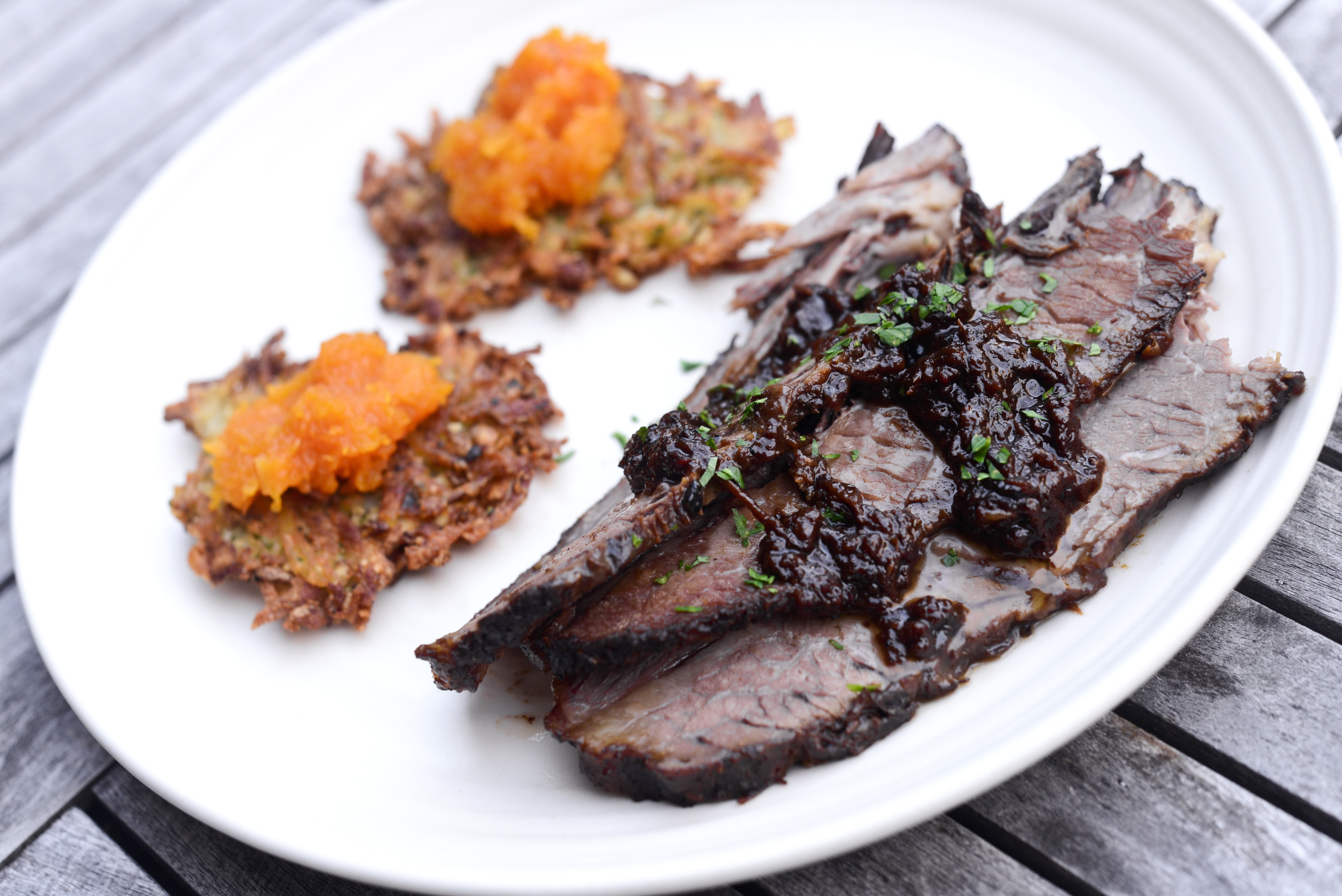 Latkes, essential to a Hanukkah meal, served with pumpkin preserves and brisket.