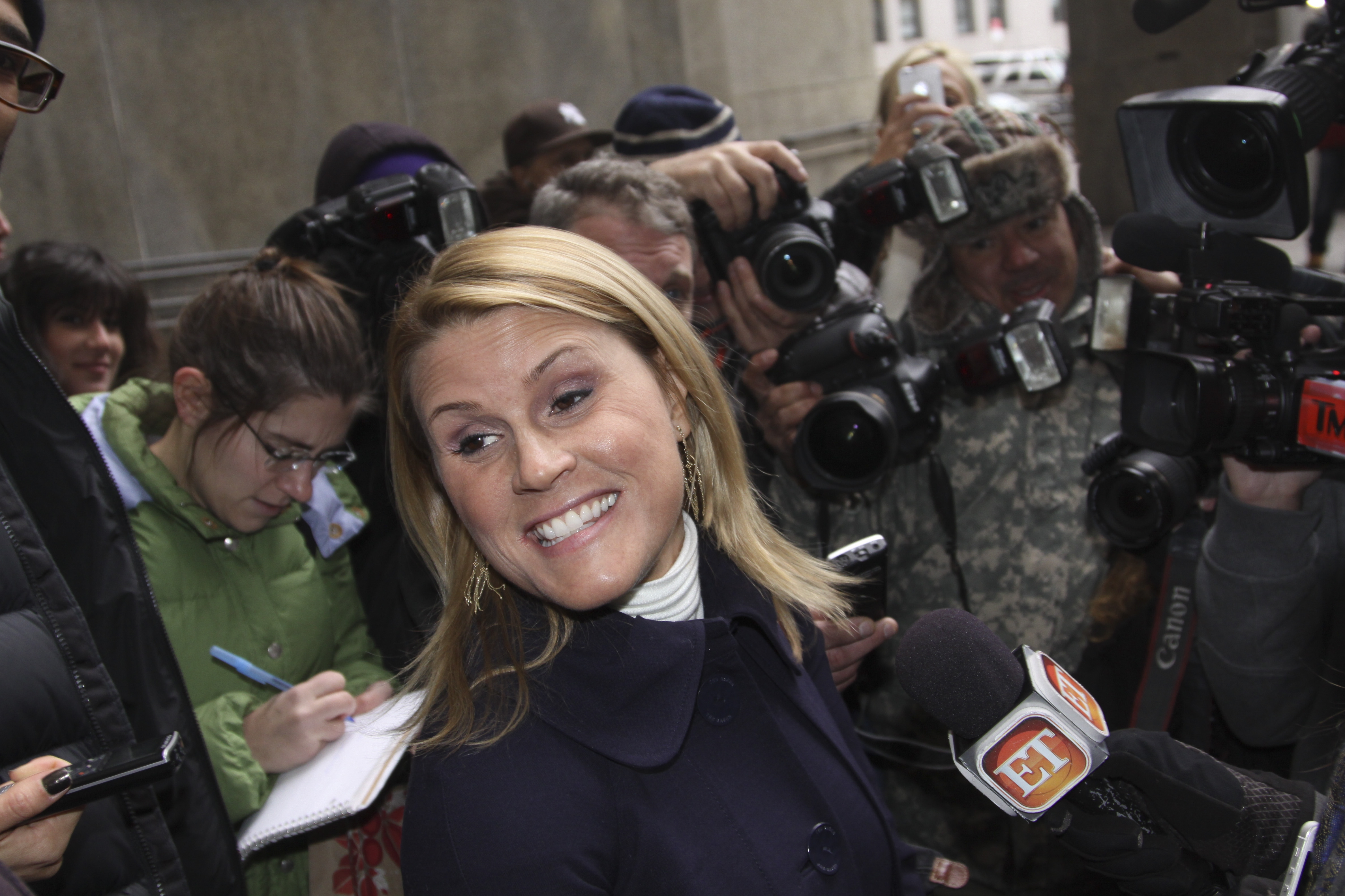 Genevieve Sabourin, charged with stalking and harassing Alec Baldwin, smiles outside court Tuesday in New York.