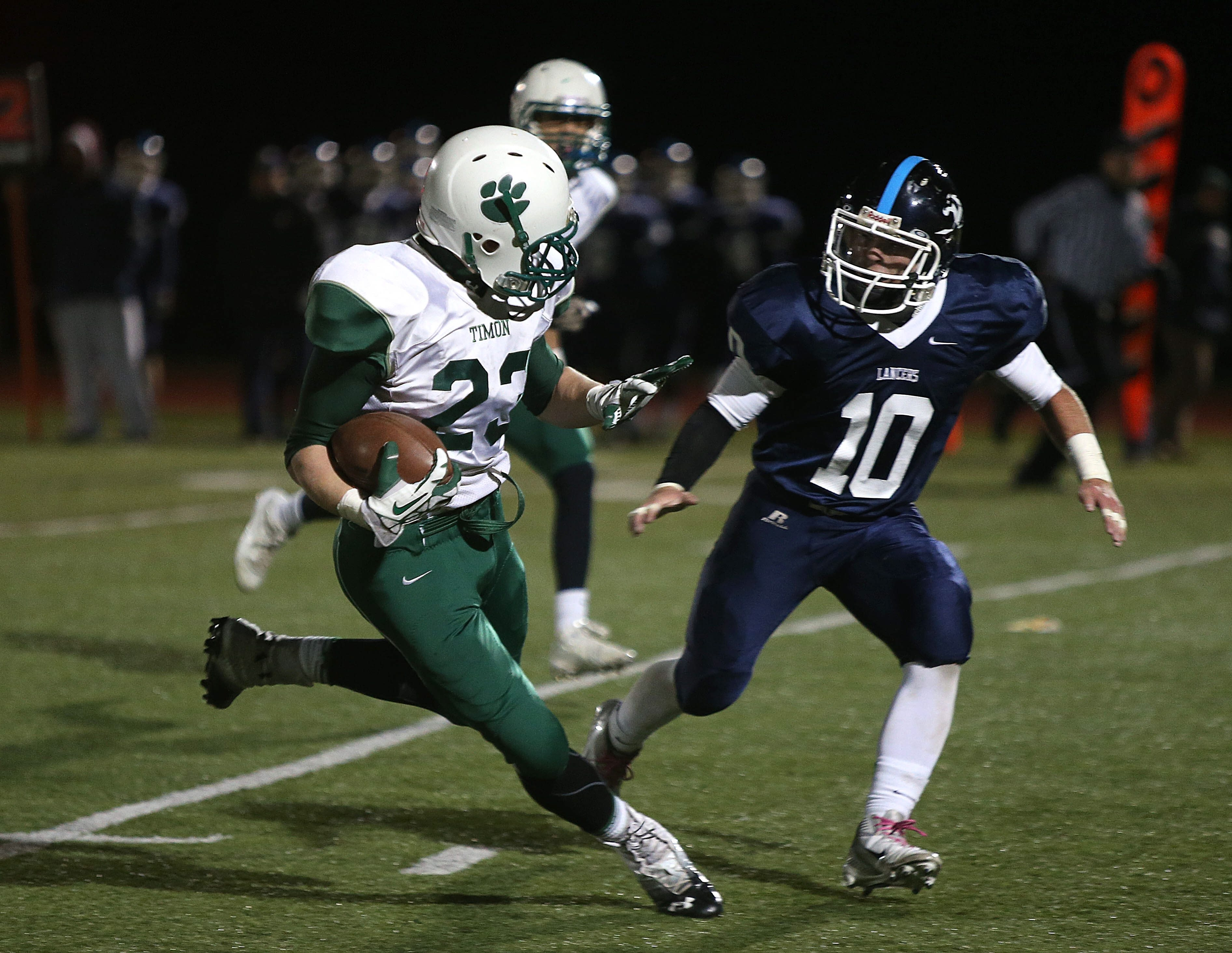 Bishop Timon-St. Jude's Gavin Caulfield is confronted by Justin Hersey (10) of St. Mary's.