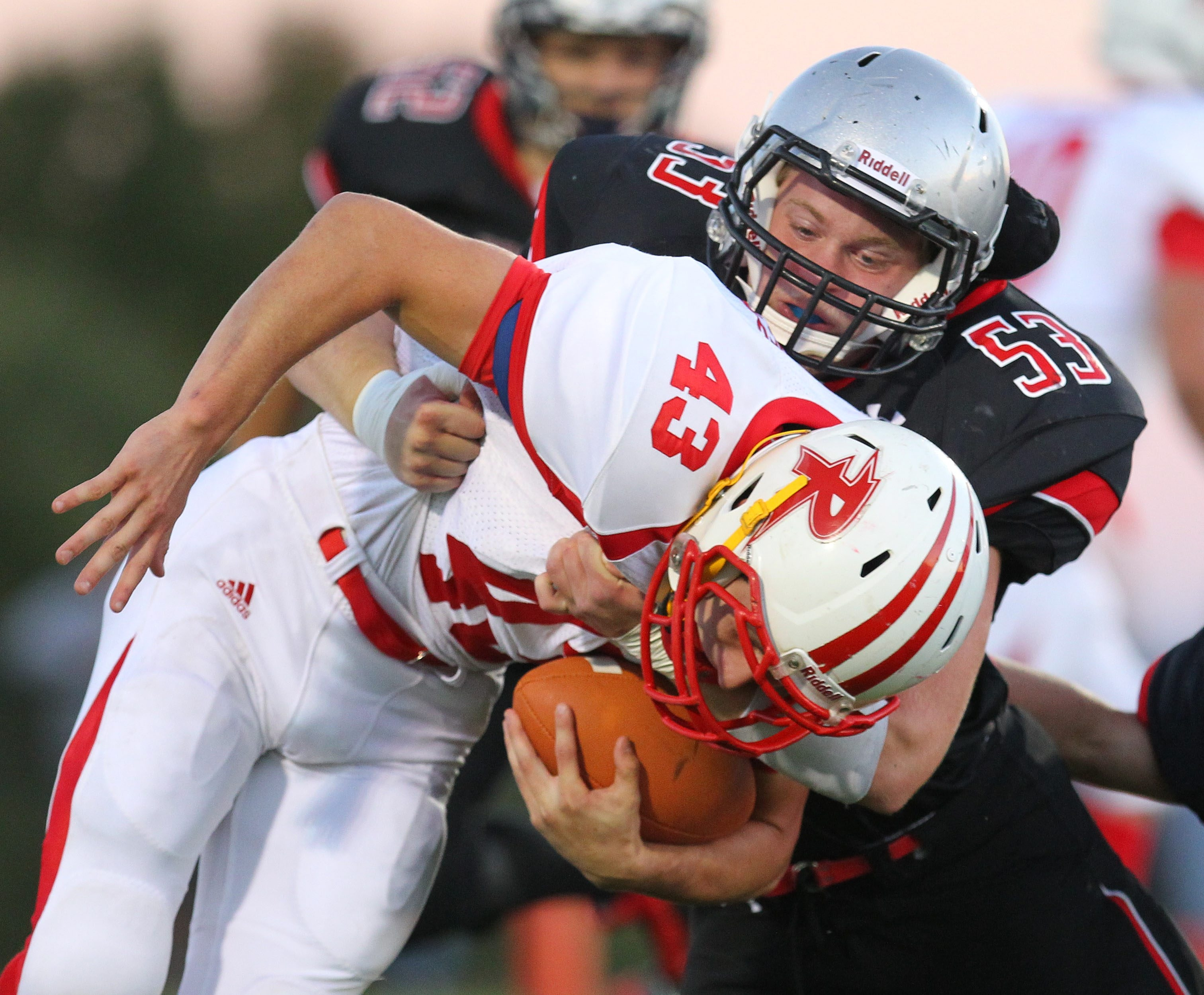 Maple Grove/Chautauqua Lake's Chandler Baker tackles Randolph's Chris Doubek during Randolph's 35-7 road victory in Week Four.