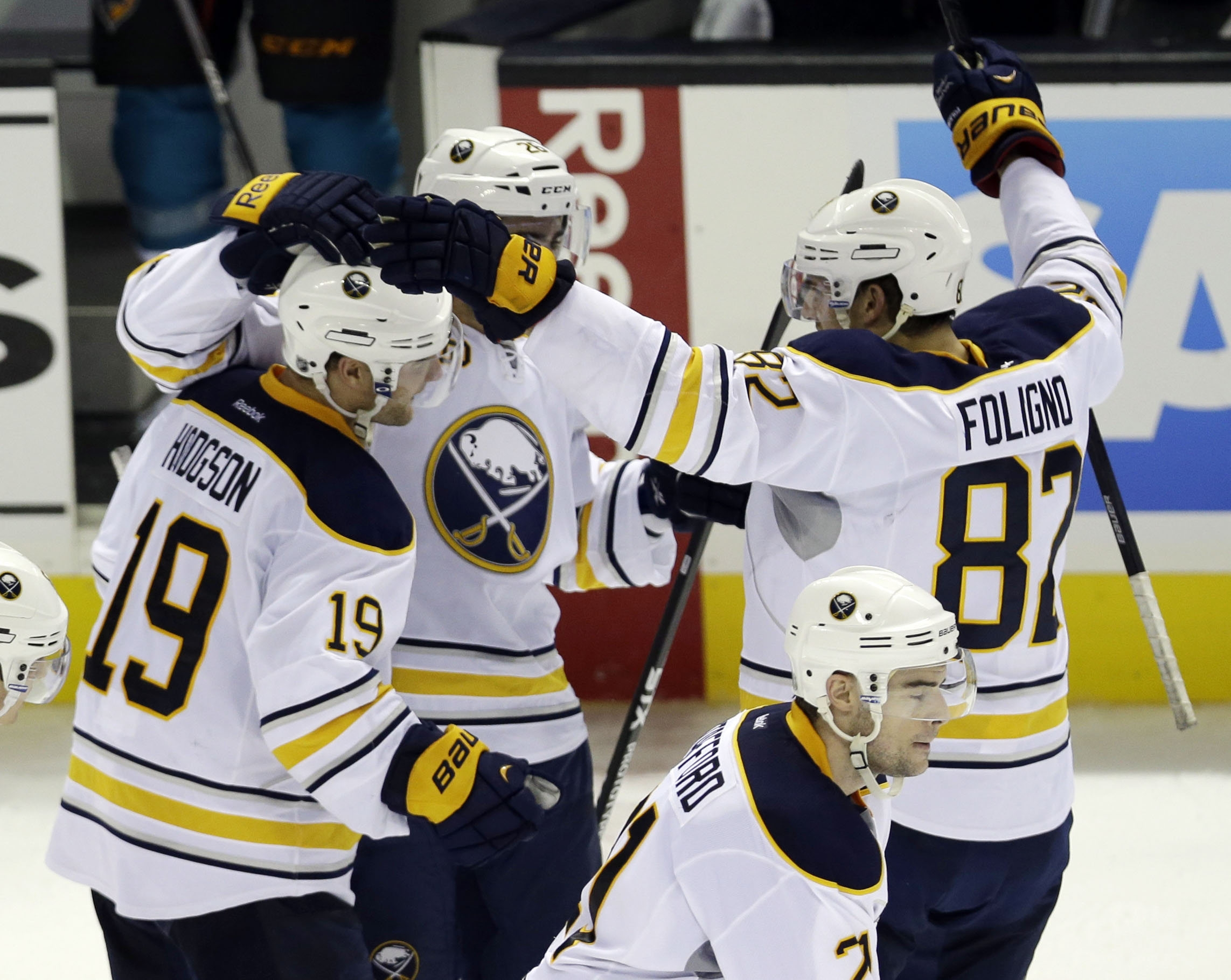 The Buffalo Sabres' Cody Hodgson (19) celebrates his shootout-winning goal late Tuesday night in San Jose as the Sabres beat the Sharks, 5-4, to start a three-game West coast road trip on a triumphant note.  (AP Photo/Marcio Jose Sanchez)