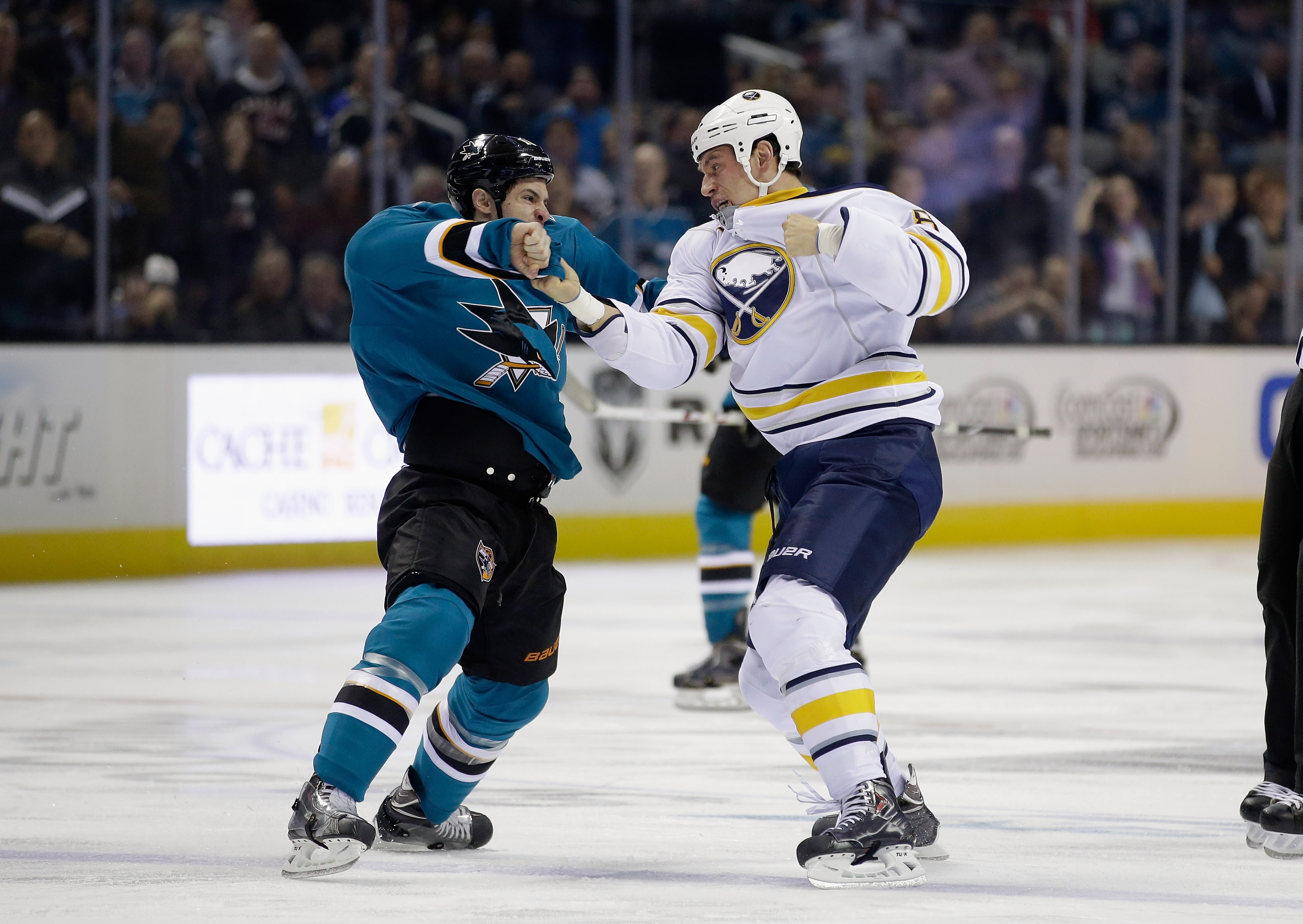 Cody McCormick, who scored one of the Sabres' goals, fights Mike Brown of the San Jose Sharks during Tuesday night's game.