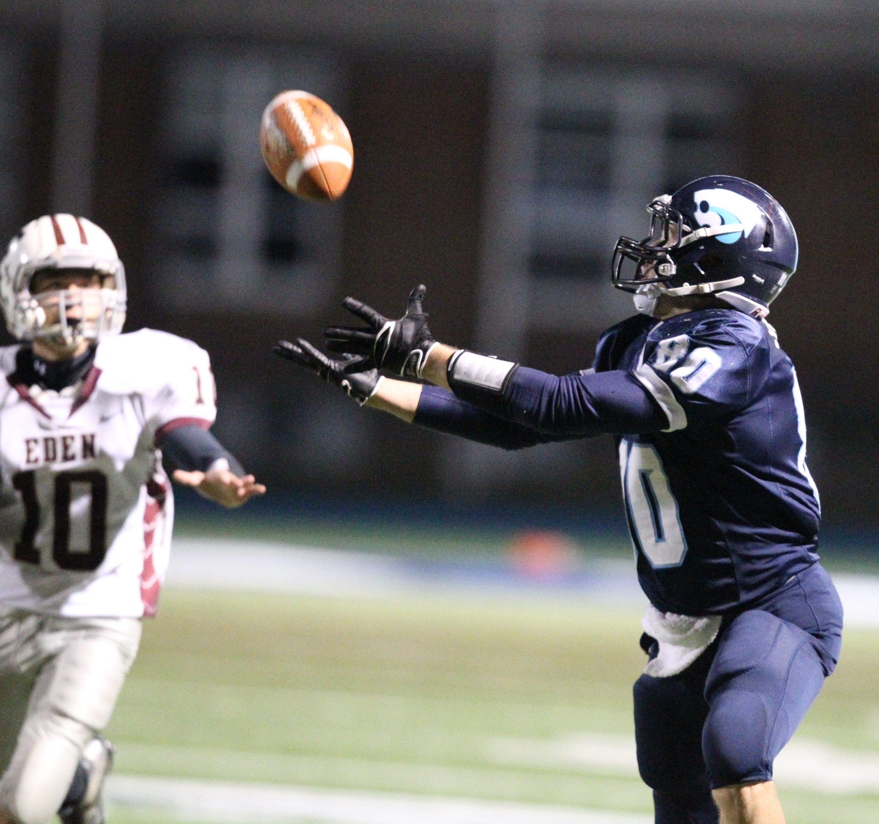 Depew receiver Derrick Sekuterski pulls in a 62-yard touchdown over Eden's Jesse Vondell in Depew's 39-17 victory.