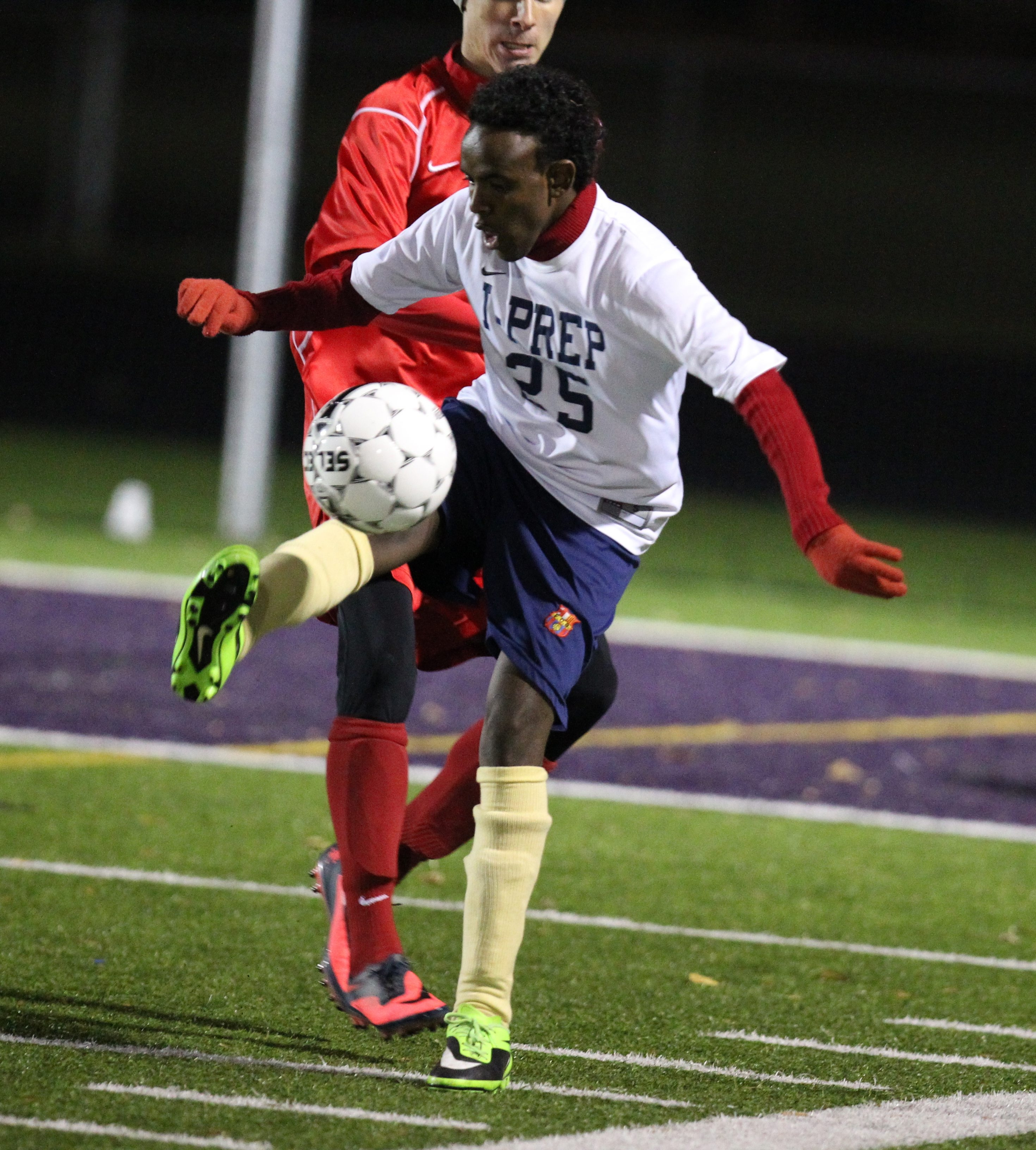 International Prep's Mohamud Abdi works the ball against Randolph in the Section VI Class C boys soccer finals at Hamburg High School .