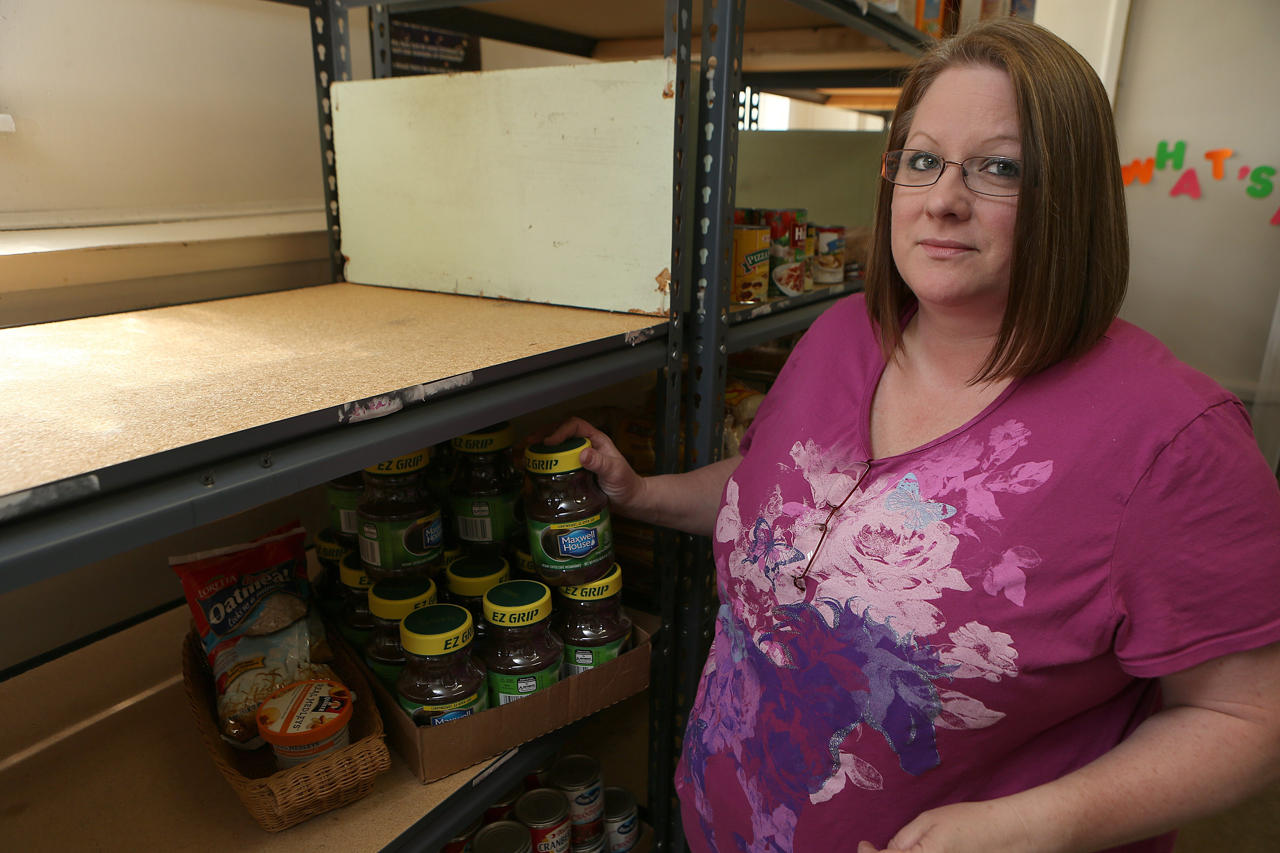Denise Noble is concerned about the mostly empty shelves in the First Baptist Church of Newfane Food Pantry.