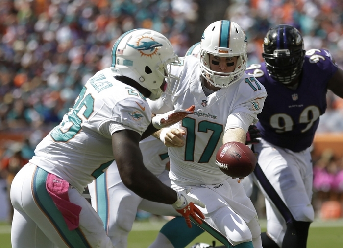 Second-year Miami Dolphins quarterback Ryan Tannehill (17) is on pace to pass for more than 4,400 yards but has already been sacked 24 times. (Associated Press)