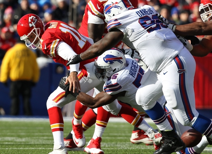 James P. McCoy/Buffalo NewsBuffalo Bills outside linebacker Jerry Hughes (55) forces a fumble on Kansas City Chiefs quarterback Alex Smith (11) in the first quarter but the Bills were unable to recover.