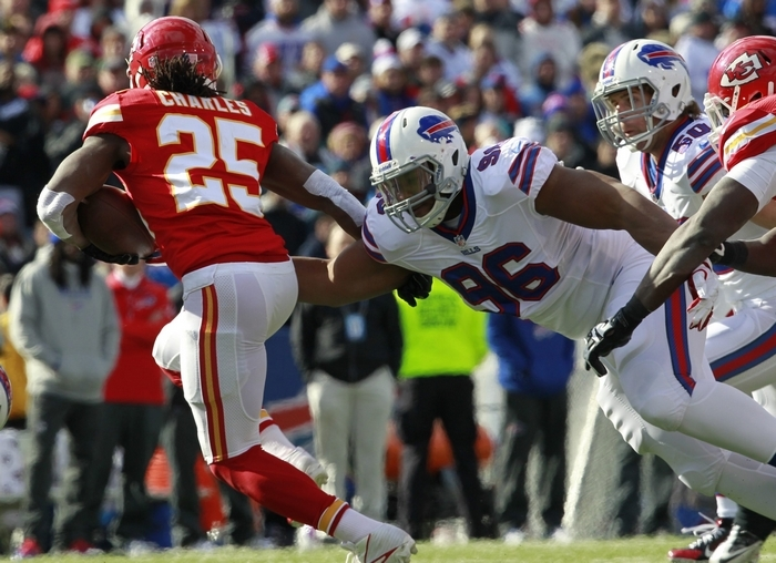 New Bills lineman Stefan Charles (96) chases Chiefs running back Jamaal Charles on one of five snaps he played against Kansas City in his NFL debut. (Harry Scull Jr./Buffalo News)