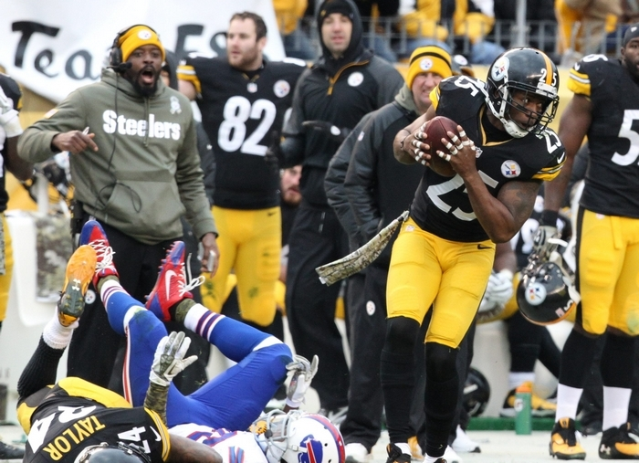 James P. McCoy/Buffalo NewsPittsburgh Steelers free safety Ryan Clark (25) intercepts an EJ Manuel pass in front of Buffalo Bills wide receiver Marquise Goodwin in the third quarter, setting up a field goal.