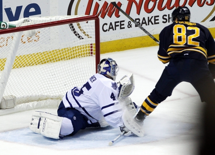 Left wing Marcus Foligno puts the Sabres ahead just after stepping out of the penalty box, slipping a backhand past Leafs goalie Jonathan Bernier. (James P. McCoy/Buffalo News)