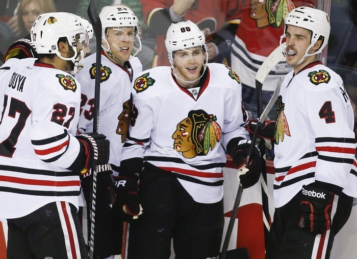 Patrick Kane, center, celebrates with Blackhawks teammates after scoring against the Calgary Flames on Wednesday. (Associated Press)
