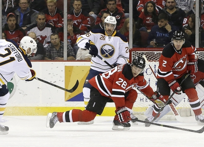 Devils defenseman Anton Volchenkov (28) reaches to block a shot by Sabres right wing Drew Stafford (21) Saturday. (Associated Press)