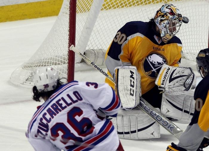 New York Rangers forward Mats Zuccarello shoots and scores during the third period against Buffalo Sabres goalie Ryan Miller. (James P. McCoy/ Buffalo News)