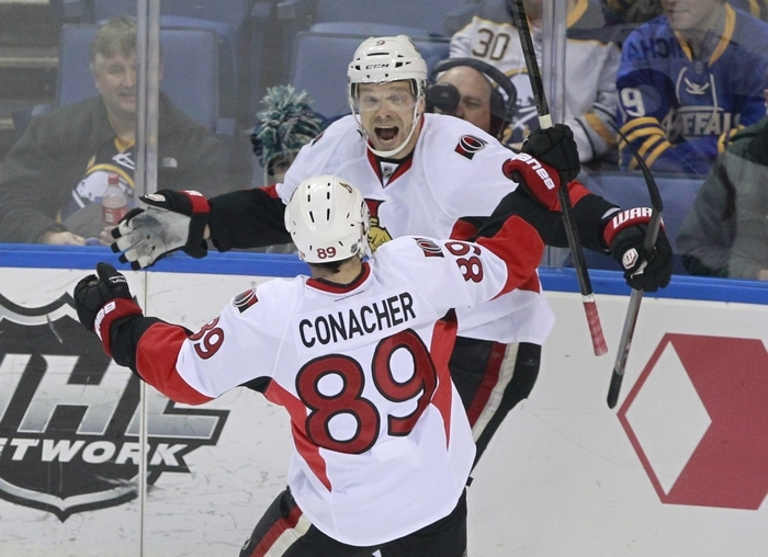 Ottawa's Milan Michalek celebrates his goal with Cory Conacher in the first period Tuesday. (Harry Scull Jr./Buffalo News)