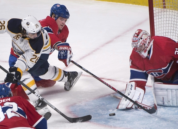 Buffalo Sabres left winger Matt Moulson (26) is crowded out by Montreal Canadiens' Douglas Murray as he tries to score on Montreal goalie Carey Price (31) during first period NHL hockey action in Montreal, Saturday, Dec. 7, 2013. (AP Photo/The Canadian Press, Peter McCabe)