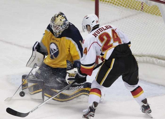 Buffalo Sabres goaltender Jhonas Enroth makes one of his 24 saves, this one on the Flames' Jiri Hudler, during Saturday's game. (Harry Scull Jr./Buffalo News)