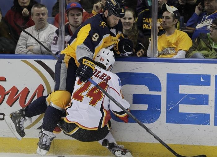 Buffalo Sabre, Steve Ott (9) checks Calgary Flame,Jiri Hudler (24) during first period action at the First Niagara Center,on,Saturday, Dec. 14, 2013(Harry Scull Jr./Buffalo News)
