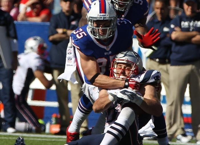 Patriots receiver Danny Amendola makes a key first down against Bills defensive back Jim Leonhard during the final drive. (James P. McCoy/Buffalo News)