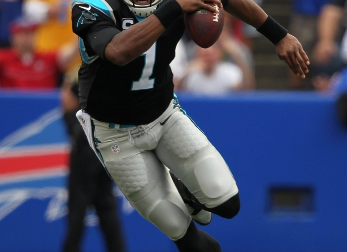 The Panthers' Cam Newton runs from the pocket in the first quarter. Newton had 15 yards on the ground Sunday. (Mark Mulville/Buffalo News)