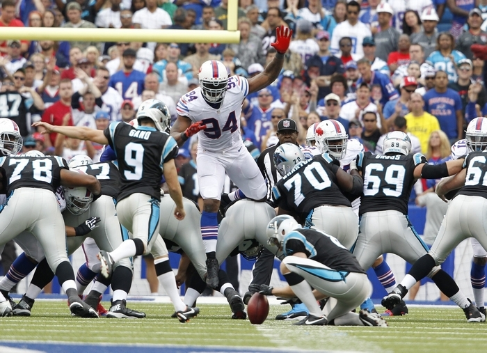 Buffalo's Mario Williams leaps in an attempt to block a fourth-quarter field goal attempt. (Harry Scull Jr./Buffalo News)