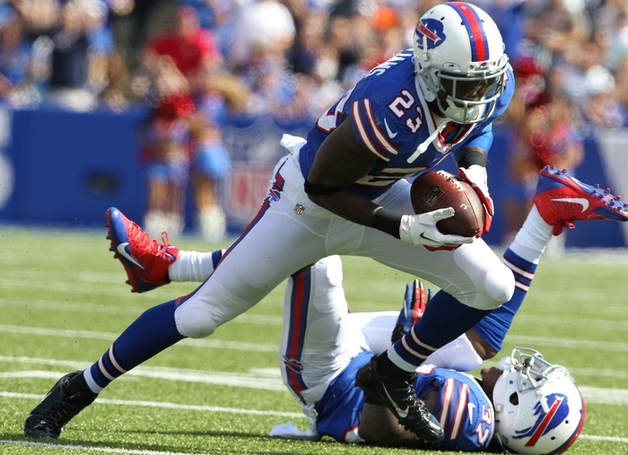 Bills cornerback Aaron Williams records one of his two interceptions Sunday. He also got banged up, leaving the game twice in the win. (James P. McCoy/Buffalo News)