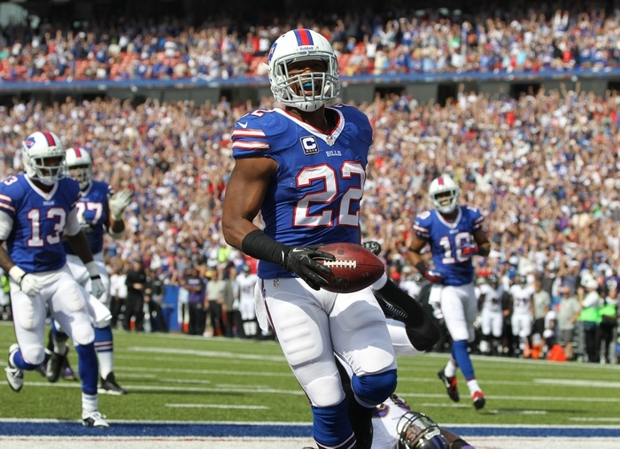Bills running back Fred Jackson (22) runs for a touchdown over Baltimore Ravens cornerback Jimmy Smith (22) in the second quarter (James P. McCoy/Buffalo News)