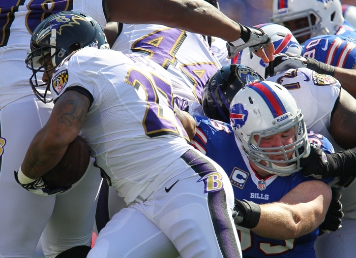 Bills defensive tackle Kyle Williams slows Ray Rice on one of the Ravens' nine rushing attempts. (Mark Mulville/Buffalo News)