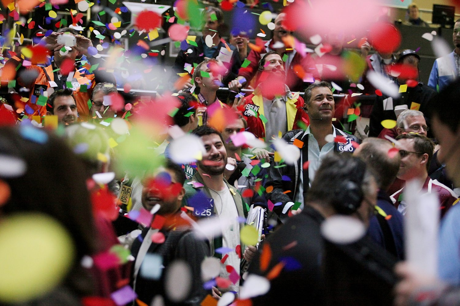 Confetti drops on traders and clerks  on the financial floor at the CME Group Inc.'s Chicago Board of Trade in Chicago on Tuesday. Stocks rose as increases in consumer confidence and housing prices built confidence in the U.S. economy.