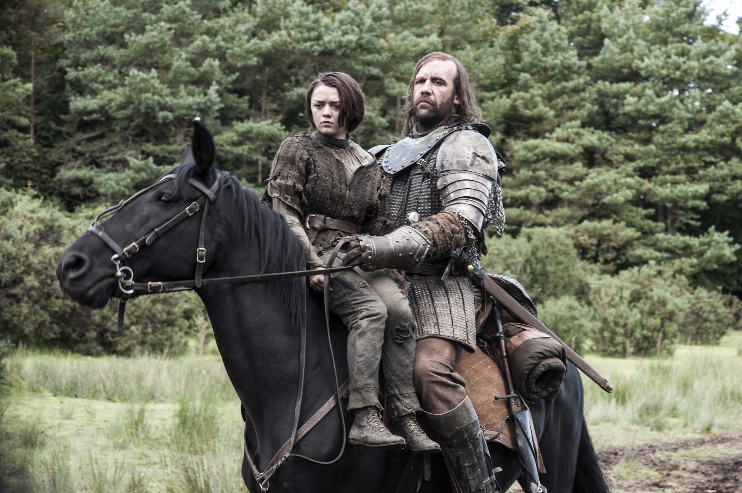 """Maisie Williams, left, and Rory McCann star in HBO's """"Game of Thrones."""" President Obama is drawn in his spare time to shows like """"Game of Thrones,"""" as well as other dark television shows whose subject matter echoes the daily strife of his workday."""