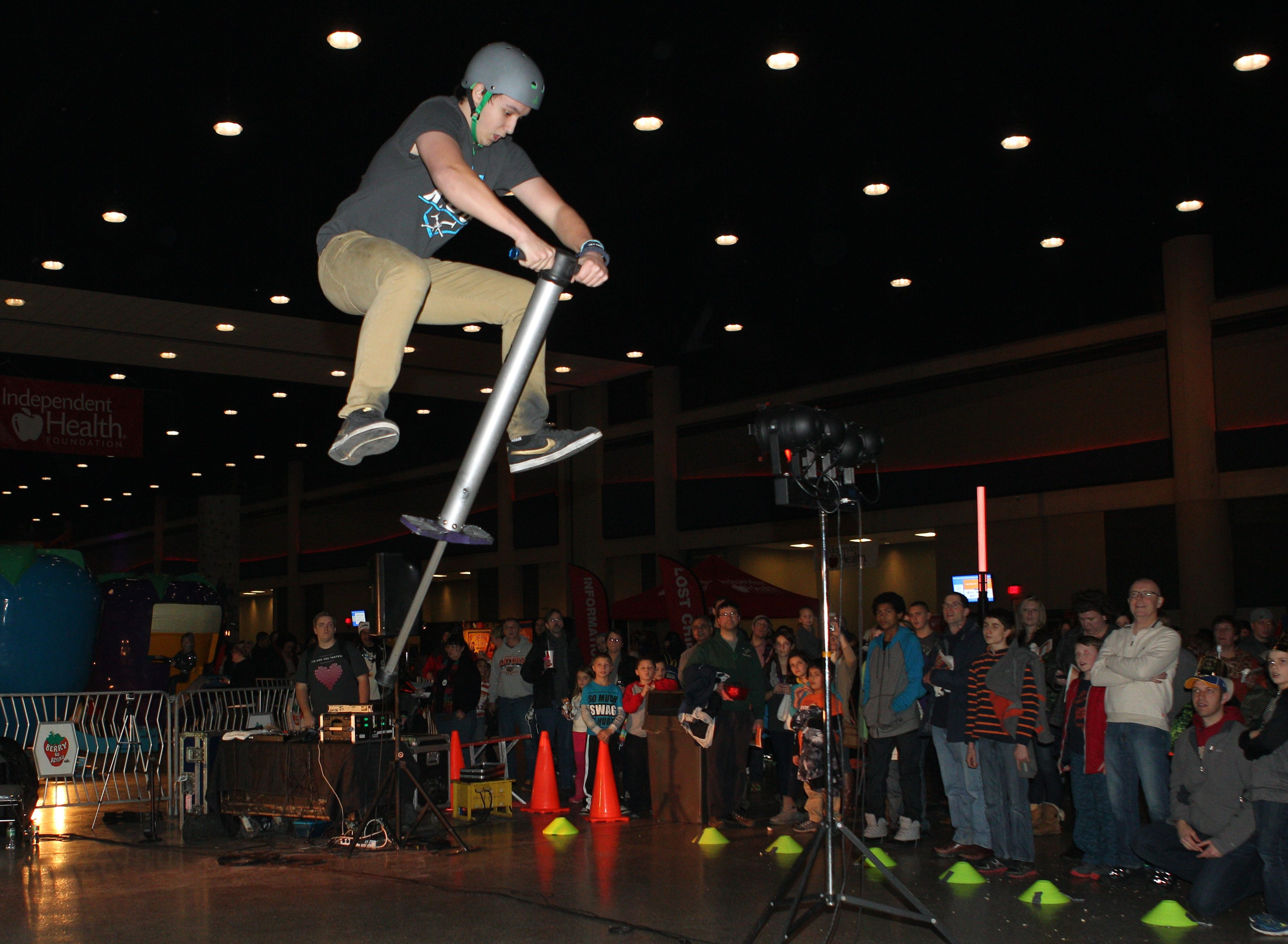 Steven Bennett, 16, a member of the Xpogo Stunt Team, entertains the crowd with his pogo jumping at First Night Buffalo at the Buffalo Convention Center Tuesday.