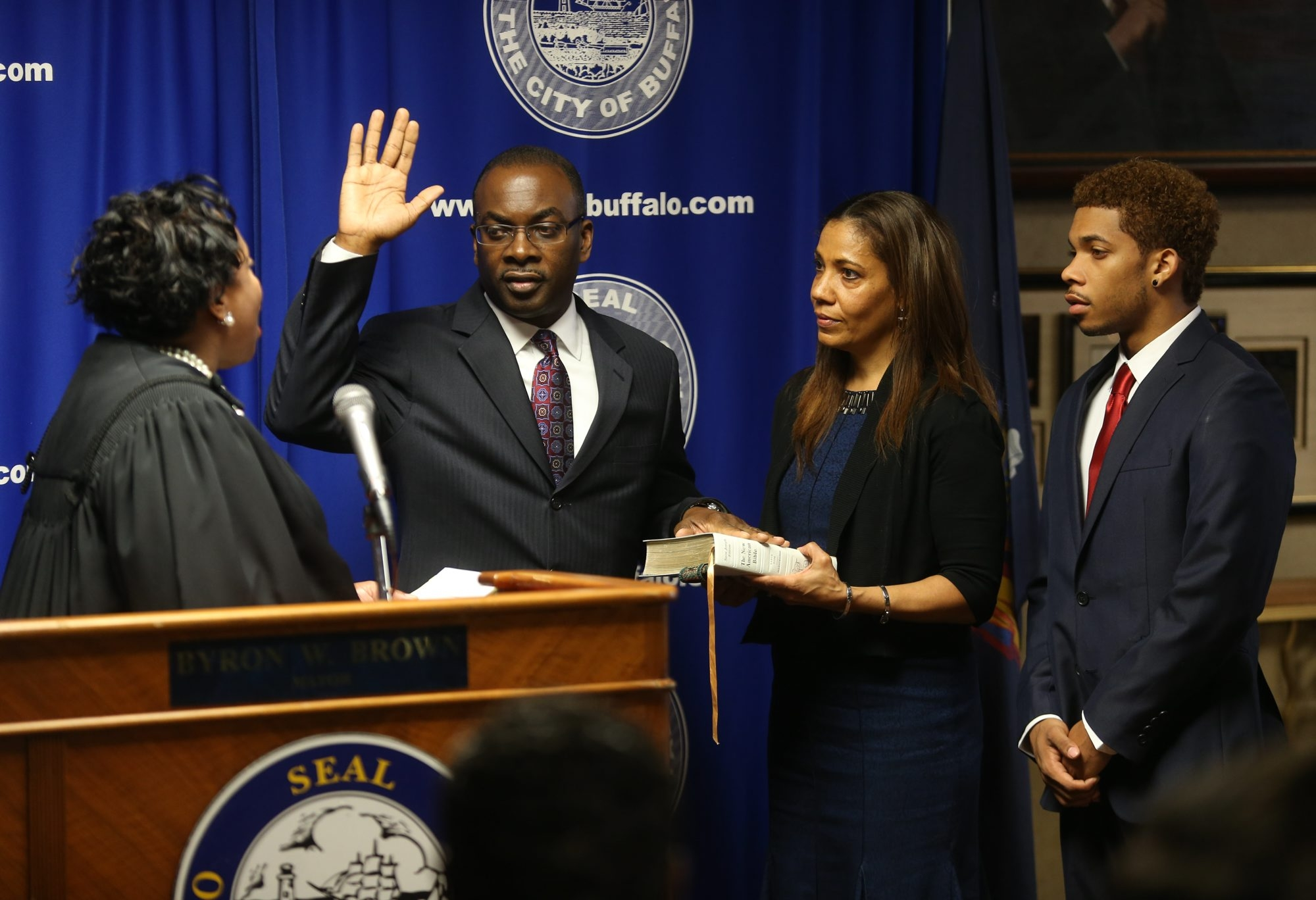 Mayor Byron W. Brown takes the oath of office from State Supreme Court Justice Shirley Troutman, as his wife, Michelle, and son, Byron III, look on, in the mayor's office at Buffalo City Hall today.