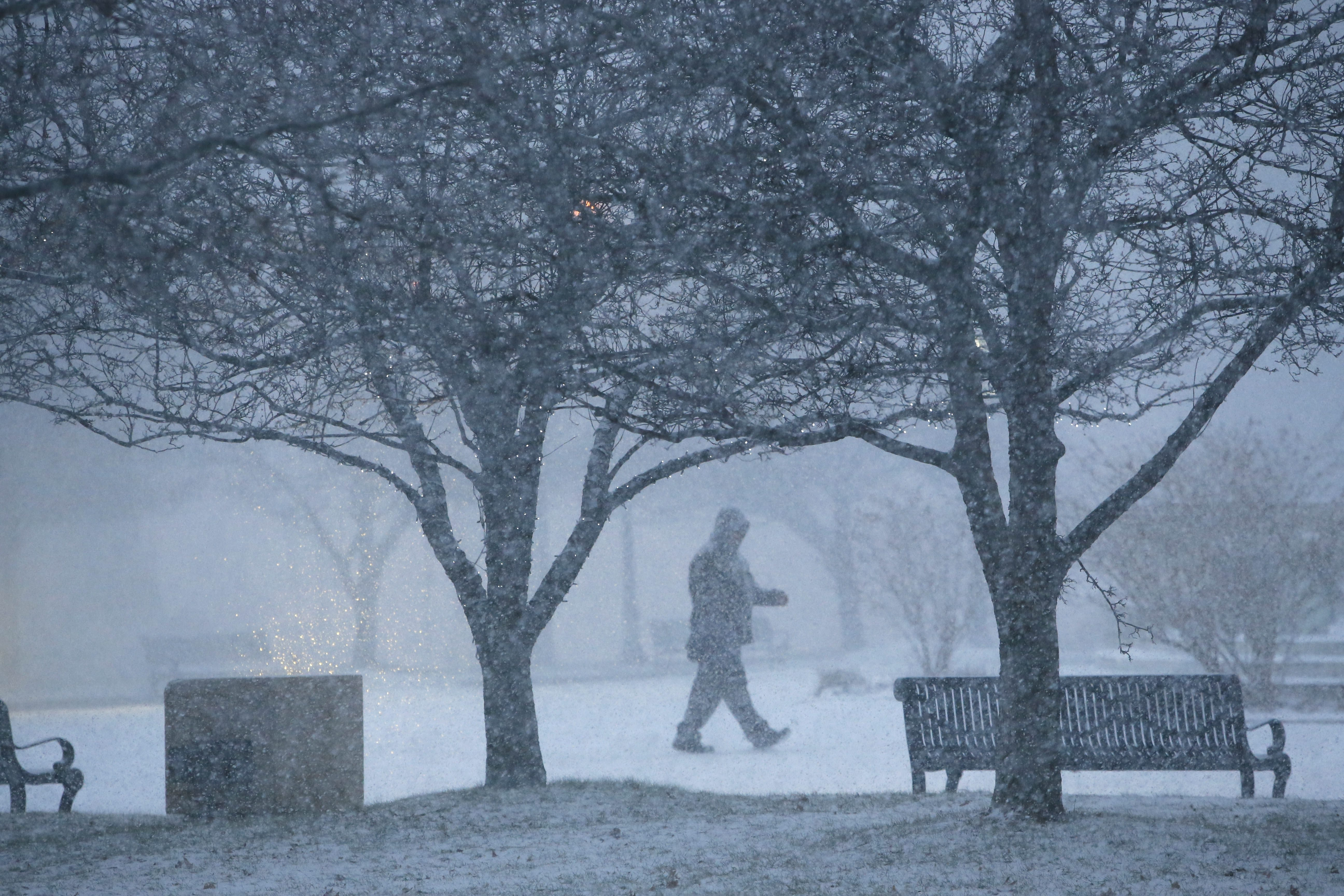 Heavy snow falls Tuesday in Niagara Square downtown. Frigid weather extends from Montana to Maine.