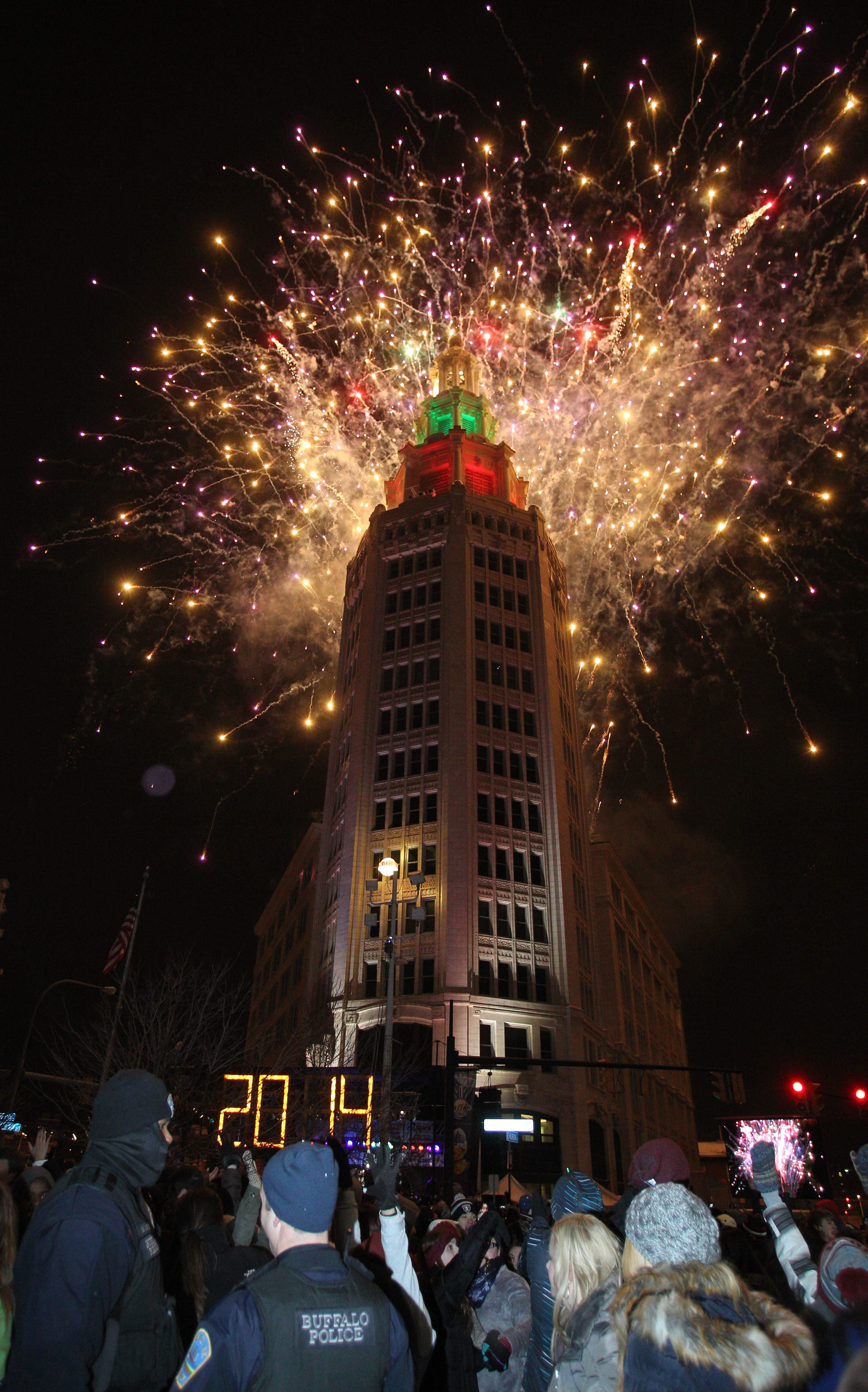 Even though temperatures were in the teens, the annual ball drop from the Electric Tower in downtown Buffalo drew thousands of revelers wanting to bring in the new year, Wednesday, Jan. 1, 2014. As the new year was ushered in, the fireworks display began. This is the finale.  (Sharon Cantillon/Buffalo News)