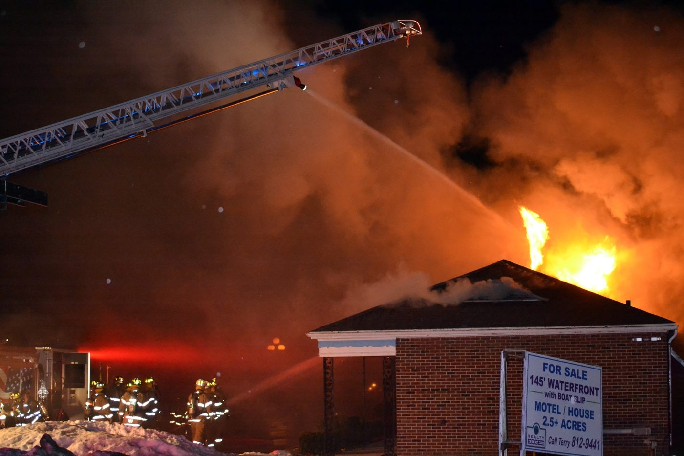 Firefighters battle the blaze overnight at the Anchor Motel on River Road.
