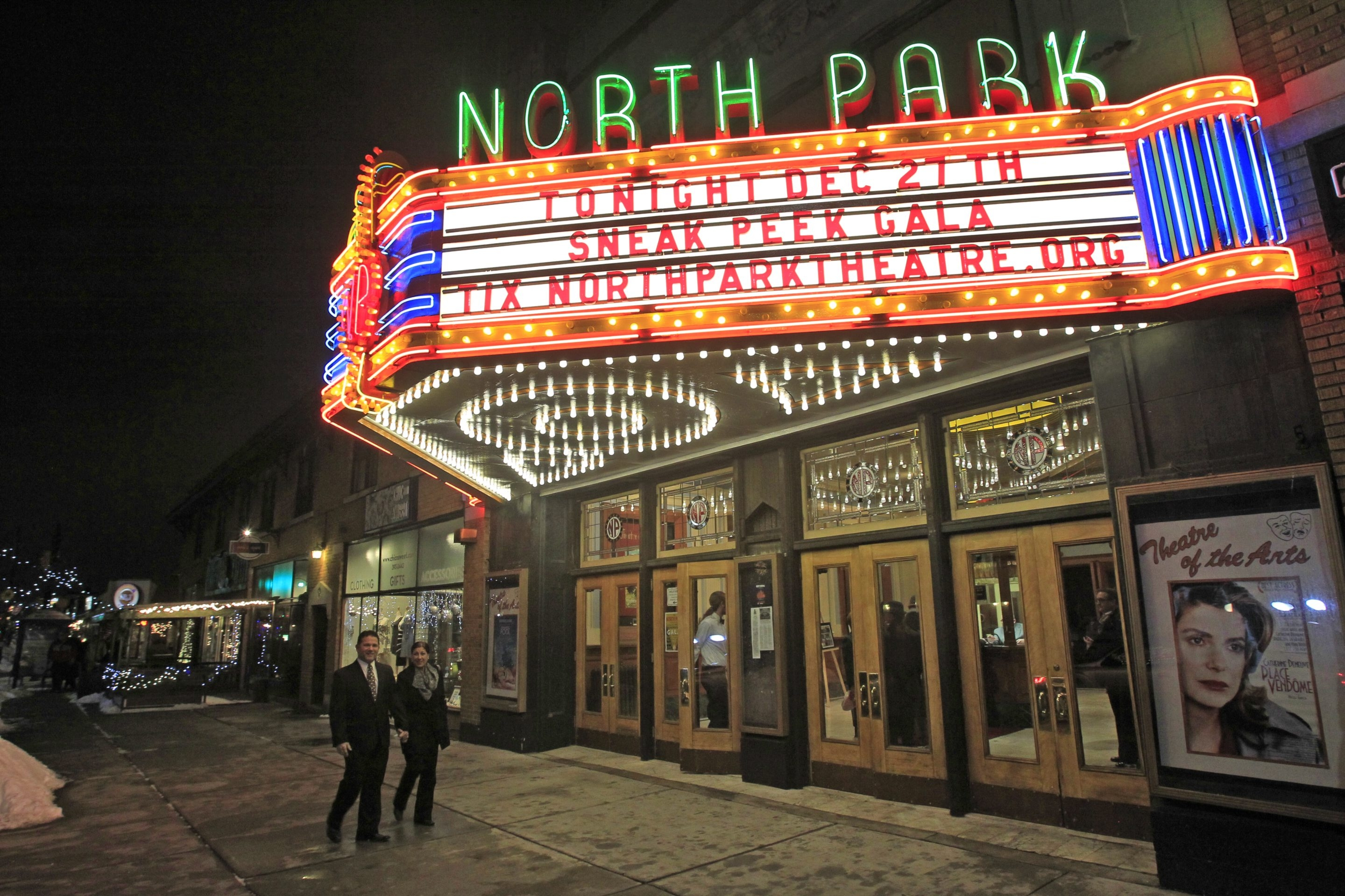 Two film fans head into the North Park Theatre to check out the restorations Friday.