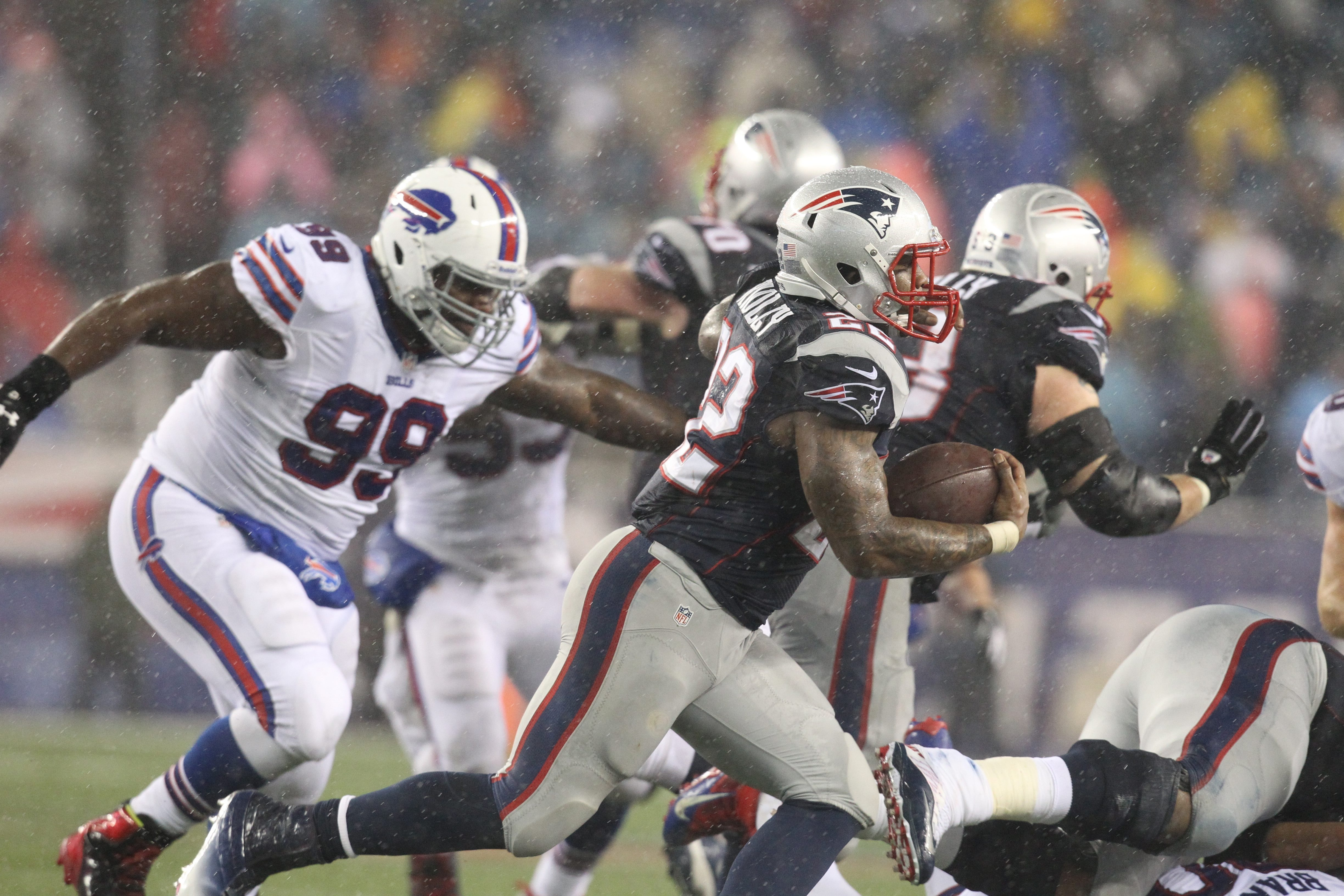 Patriots running back Stevan Ridley (22) beats Bills defensive tackle Marcell Dareus (99) in the third quarter during Sunday's game.