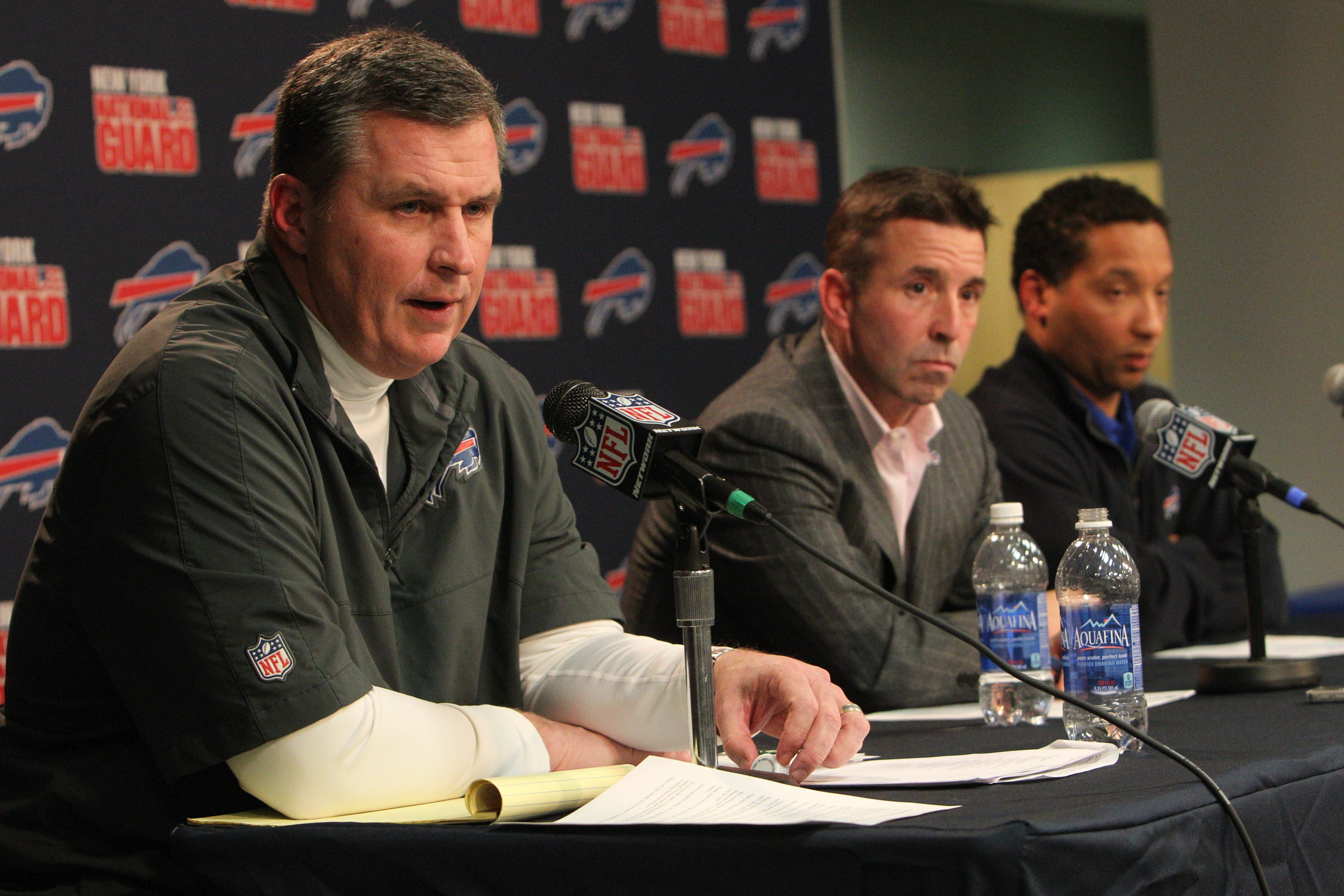 Bills coach Doug Marrone, left, appears at a news conference Monday with Bills President and CEO Russ Brandon, center, and General Manager Doug Whaley.